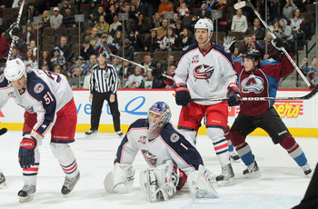 DENVER, CO - MARCH 22:  Goalie Steve Mason #1 of the Columbus Blue Jackets reacts and Matt Duchene #9 of the Colorado Avalanche celebrates after a shot by Daniel Winnik of the Colorado Avalanche scores with three seconds left in the game to tie the score