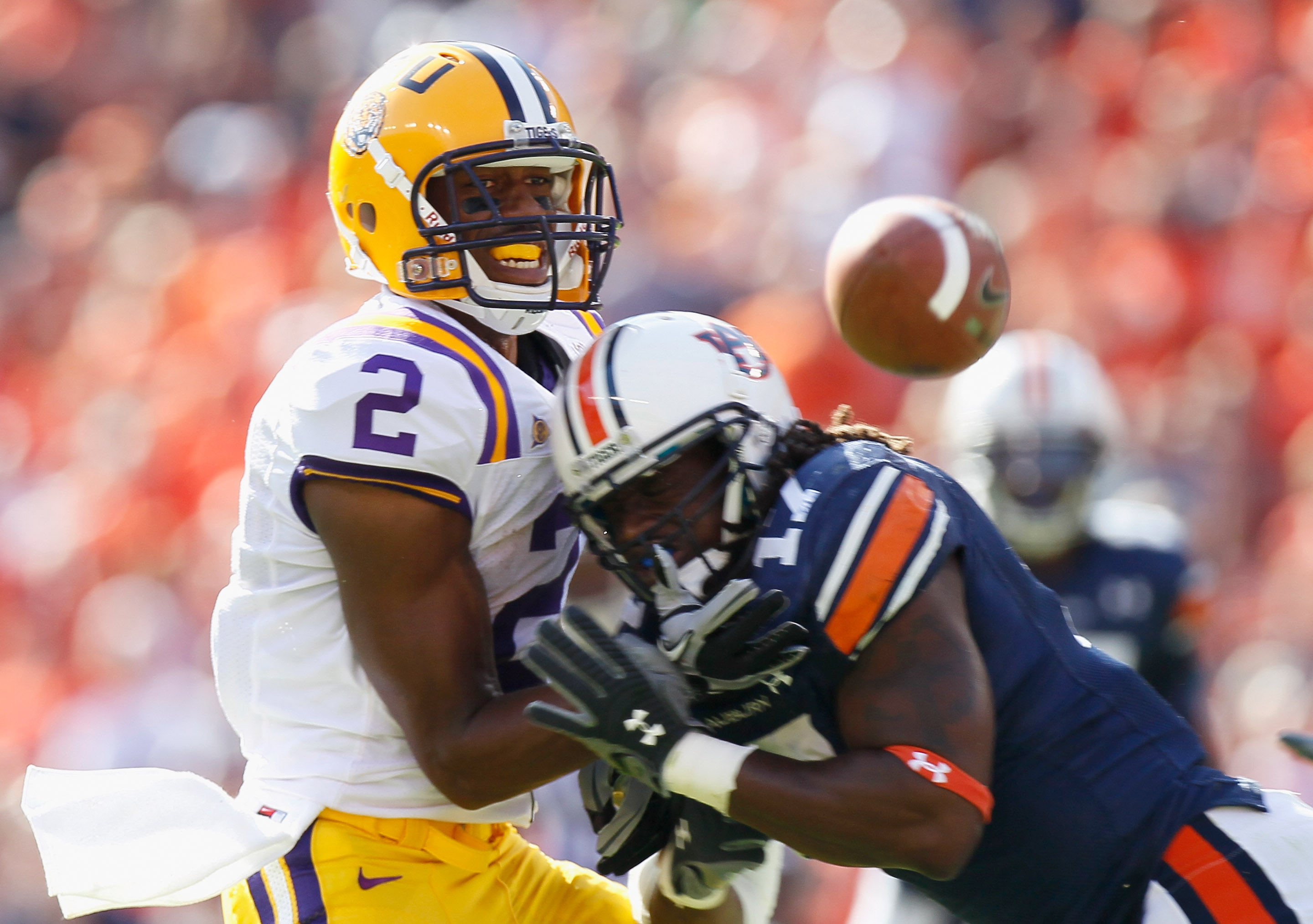 AUBURN, AL - OCTOBER 23:  Josh Bynes #17 of the Auburn Tigers forces an interception as he breaks up a pass intended for Rueben Randle #2 of the LSU Tigers at Jordan-Hare Stadium on October 23, 2010 in Auburn, Alabama.  (Photo by Kevin C. Cox/Getty Images