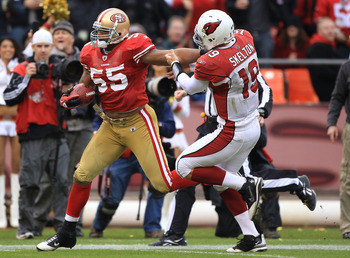 SAN FRANCISCO, CA - JANUARY 2:  Ahamd Brooks #55 of the San Francisco 49ers runs an interception back against John Skelton #19 of the Arizona Cardinals during an NFL game at Candlestick Park on January 2, 2011 in San Francisco, California.(Photo by Jed Ja