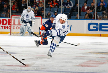 UNIONDALE, NY - FEBRUARY 08:  Tomas Kaberle #15 of the Toronto Maple Leafs takes a shot against the New York Islanders on February 8, 2011 at Nassau Colsium in Uniondale, New York.  (Photo by Lou Capozzola/Getty Images)