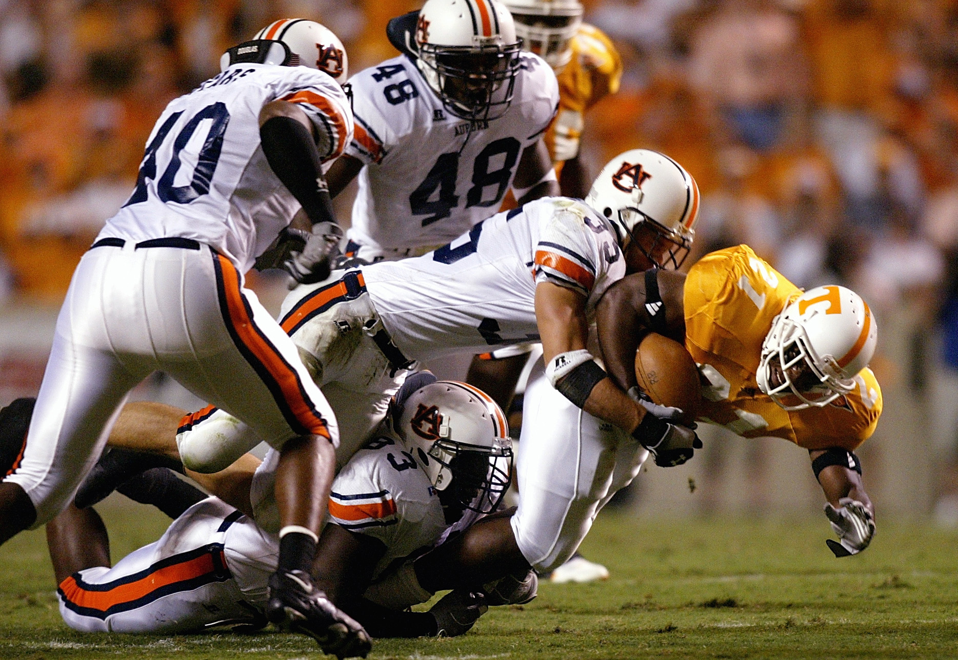 KNOXVILLE, TN - OCTOBER 2:  Cedric Houston #21 of the Tennessee Volunteers is swarmed by the Auburn Tigers defense at Neyland Stadium on October 2, 2004 in Knoxville, Tennessee. (Photo by Streeter Lecka/Getty Images)