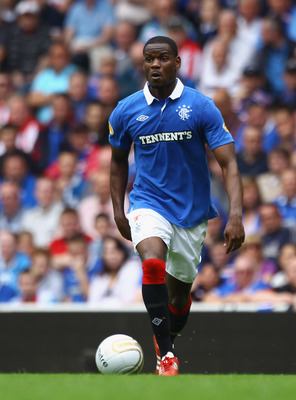GLASGOW, SCOTLAND - MAY 07:  Maurice Edu of Rangers in action during the Clydesdale Bank Premier League match between Rangers and Hearts at Ibrox Stadium salutes his supporters on May 7, 2011 in Glasgow, Scotland.  (Photo by Jeff J Mitchell/Getty Images)
