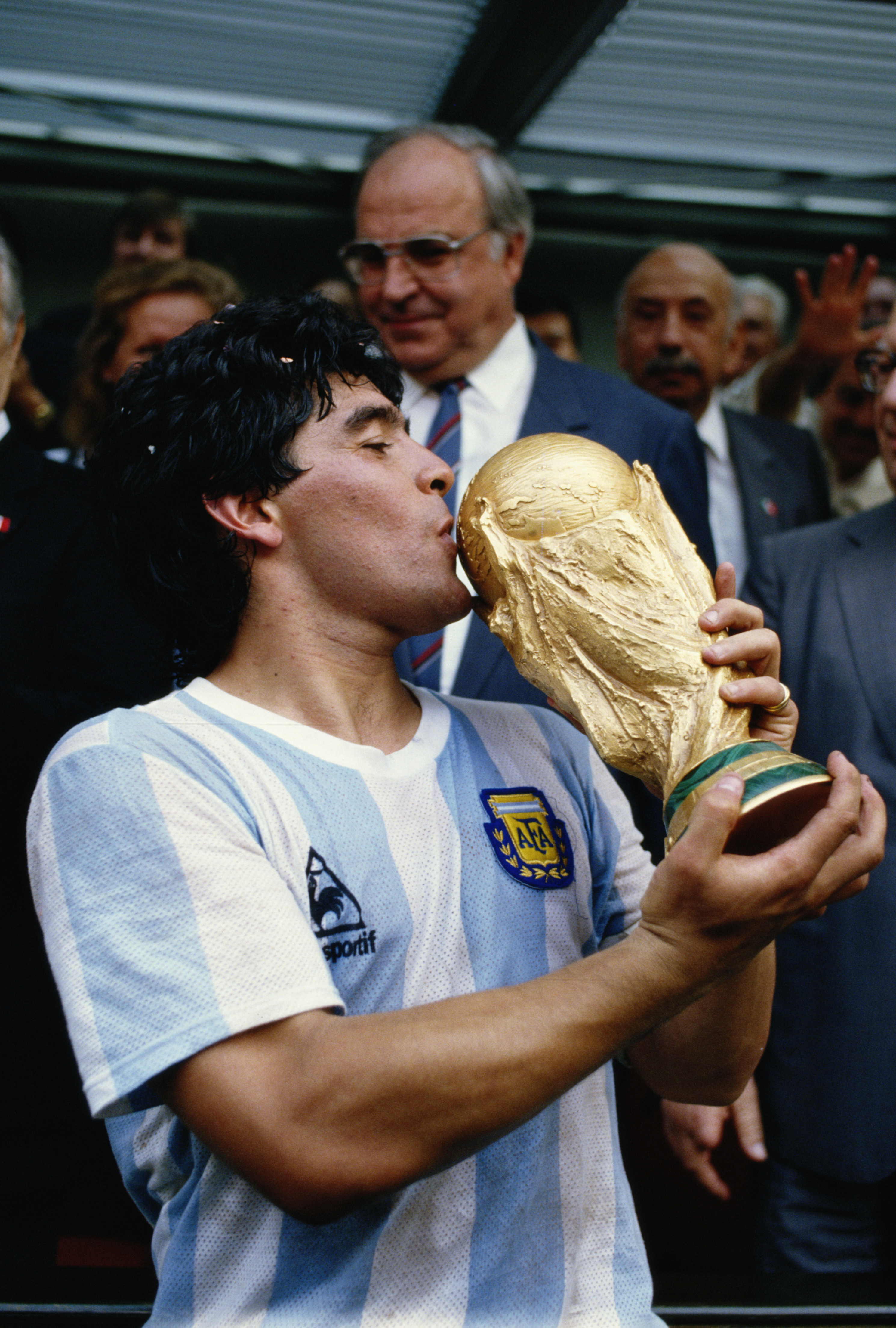 29 Jul 1986:  Diego Maradona of Argentina kisses the trophy after the World Cup final against West Germany at the Azteca Stadium in Mexico City. Argentina won the match 3-2. \ Mandatory Credit: Allsport UK /Allsport