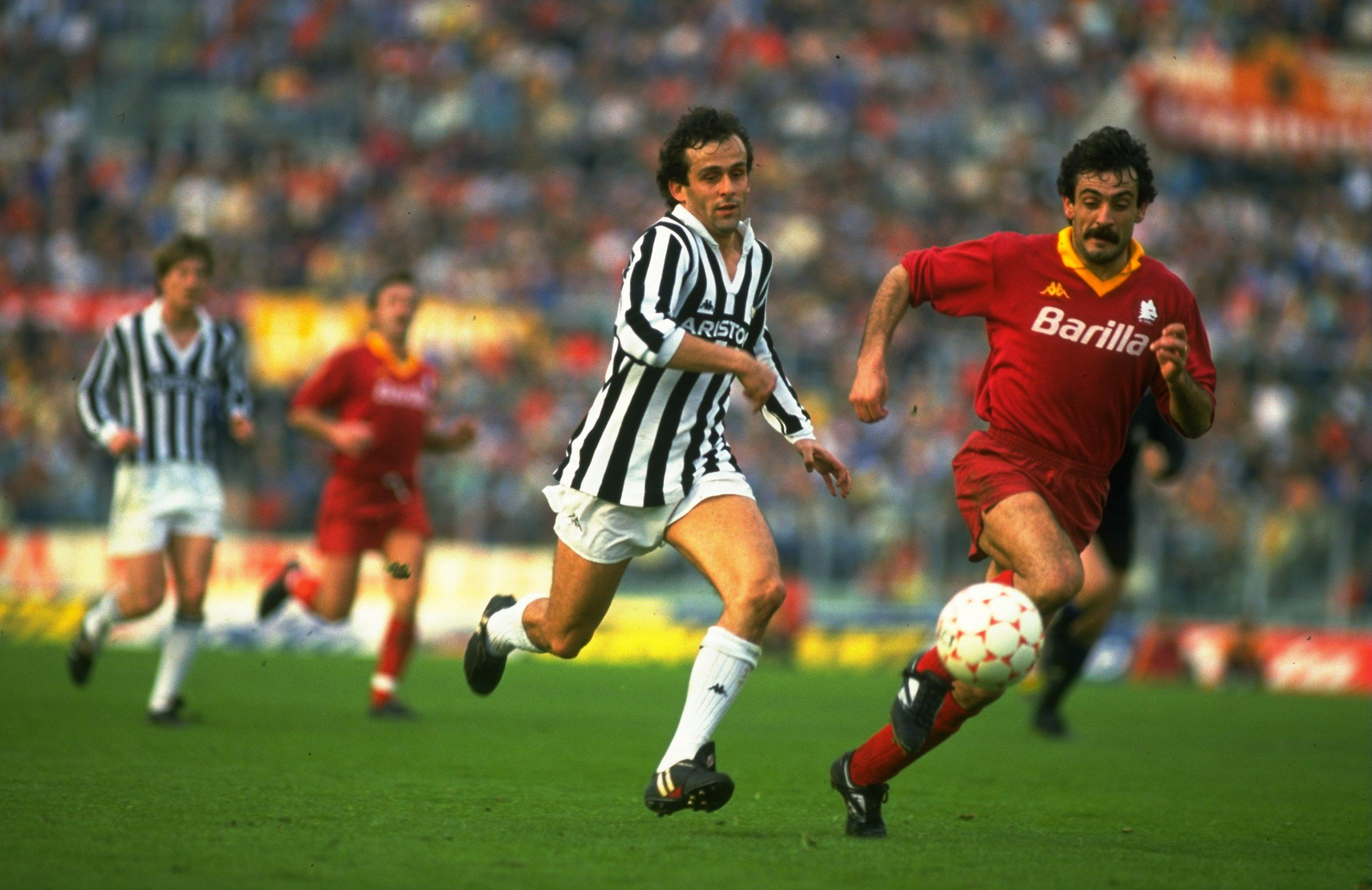 Undated:  Michel Platini (left) of Juventus chases Emidio Oddi of Roma  during an Italian League match at the Olympic Stadium in Rome. Roma won the match 3-0. \ Mandatory Credit: Allsport UK /Allsport