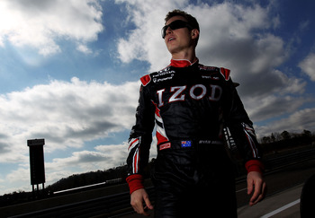 BIRMINGHAM, AL - MARCH 15: Ryan Briscoe of Australia, driver of the #6 Team Penske Dallara Honda stands in pit lane during IZOD IndyCar Series Spring Training at Barber Motorsports Park on March 15, 2011 in Birmingham, Alabama.  (Photo by Nick Laham/Getty