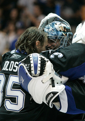 TAMPA, FL - MAY 21:  Dwayne Roloson #35 hugs Mike Smith #41 of the Tampa Bay Lightning after they defeated the Boston Bruins 5 to 3 in Game Four of the Eastern Conference Finals during the 2011 NHL Stanley Cup Playoffs at St Pete Times Forum on May 21, 20