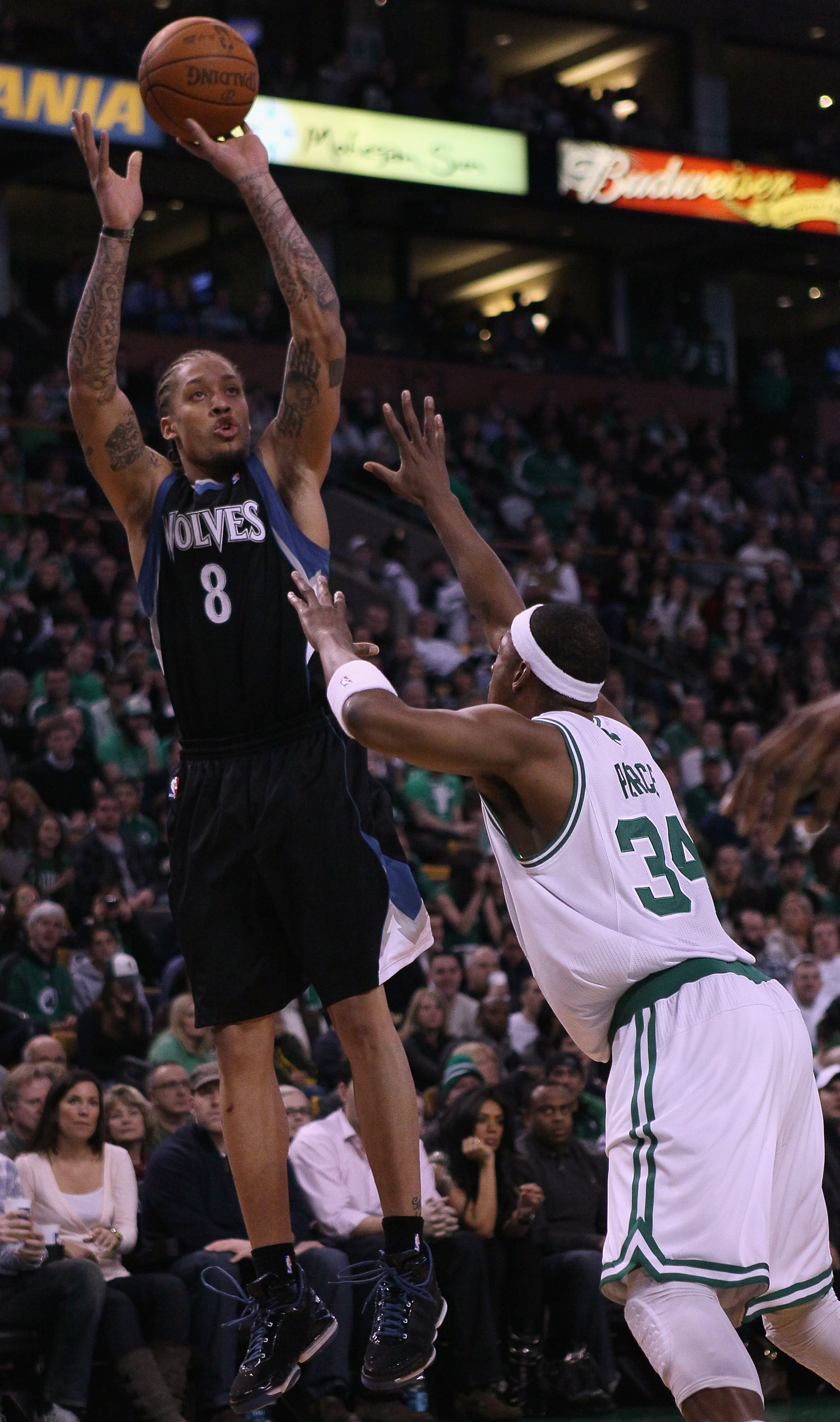 BOSTON, MA - JANUARY 03:  Michael Beasley #8 of the Minnesota Timberwolves takes a shot as Paul Pierce #34 of the Boston Celtics defends on January 3, 2011 at the TD Garden in Boston, Massachusetts. NOTE TO USER: User expressly acknowledges and agrees tha