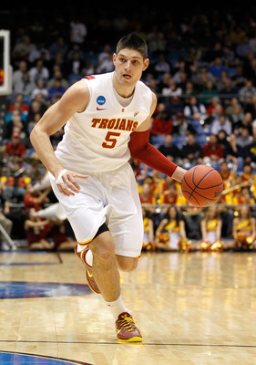 DAYTON, OH - MARCH 16: Nikola Vucevic #5 of the USC Trojans handles the ball against the Virginia Commonwealth Rams during the first round of the 2011 NCAA men's basketball tournament at UD Arena on March 16, 2011 in Dayton, Ohio.  (Photo by Gregory Shamu