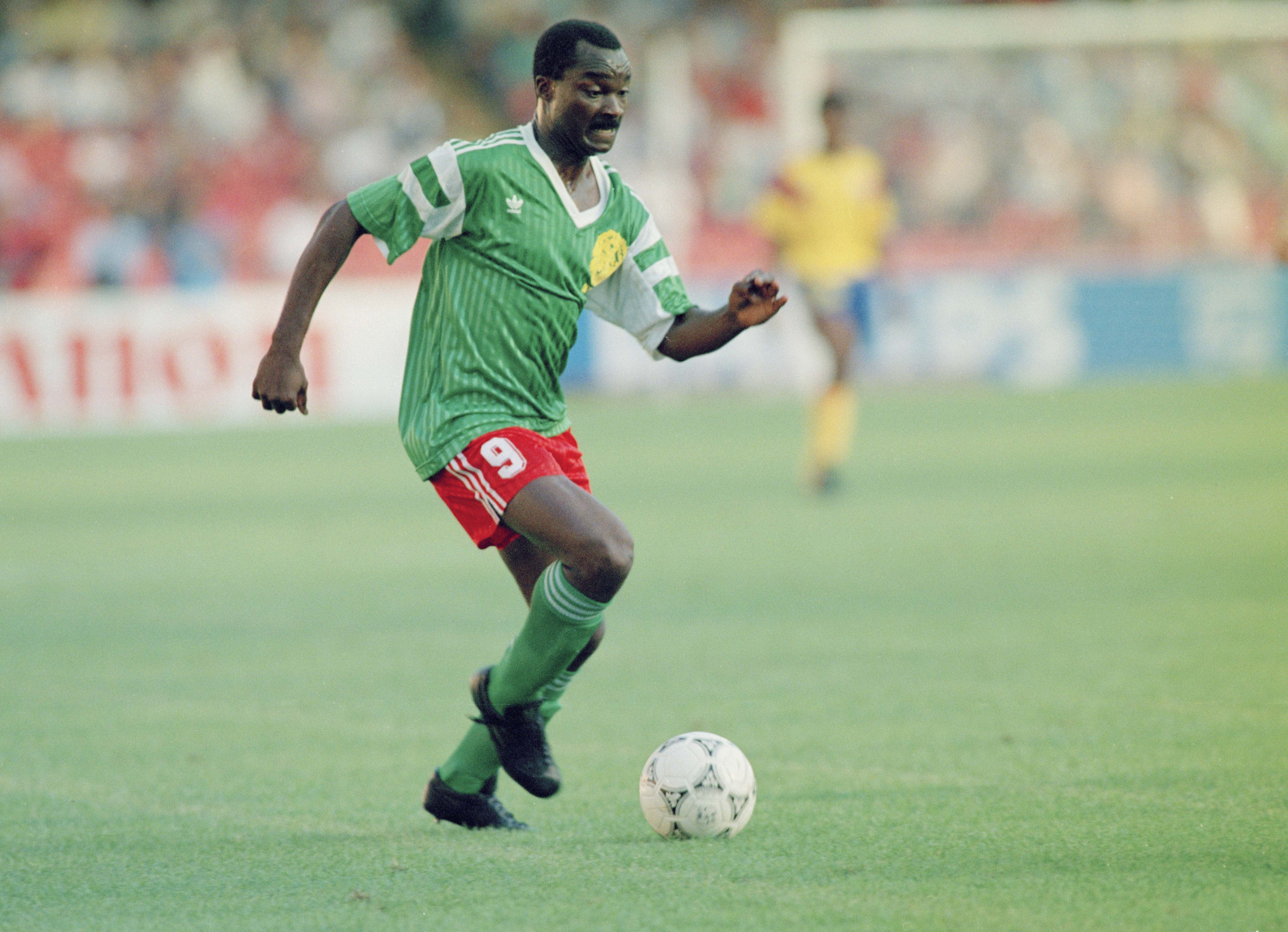 Cameroonian footballer Roger Milla in action against Colombia, during the knockout stage of the World Cup, at the Stadio San Paolo, Naples, Italy, 23rd June 1990. Cameroon woin the match 2-1. (Photo by Getty Images)