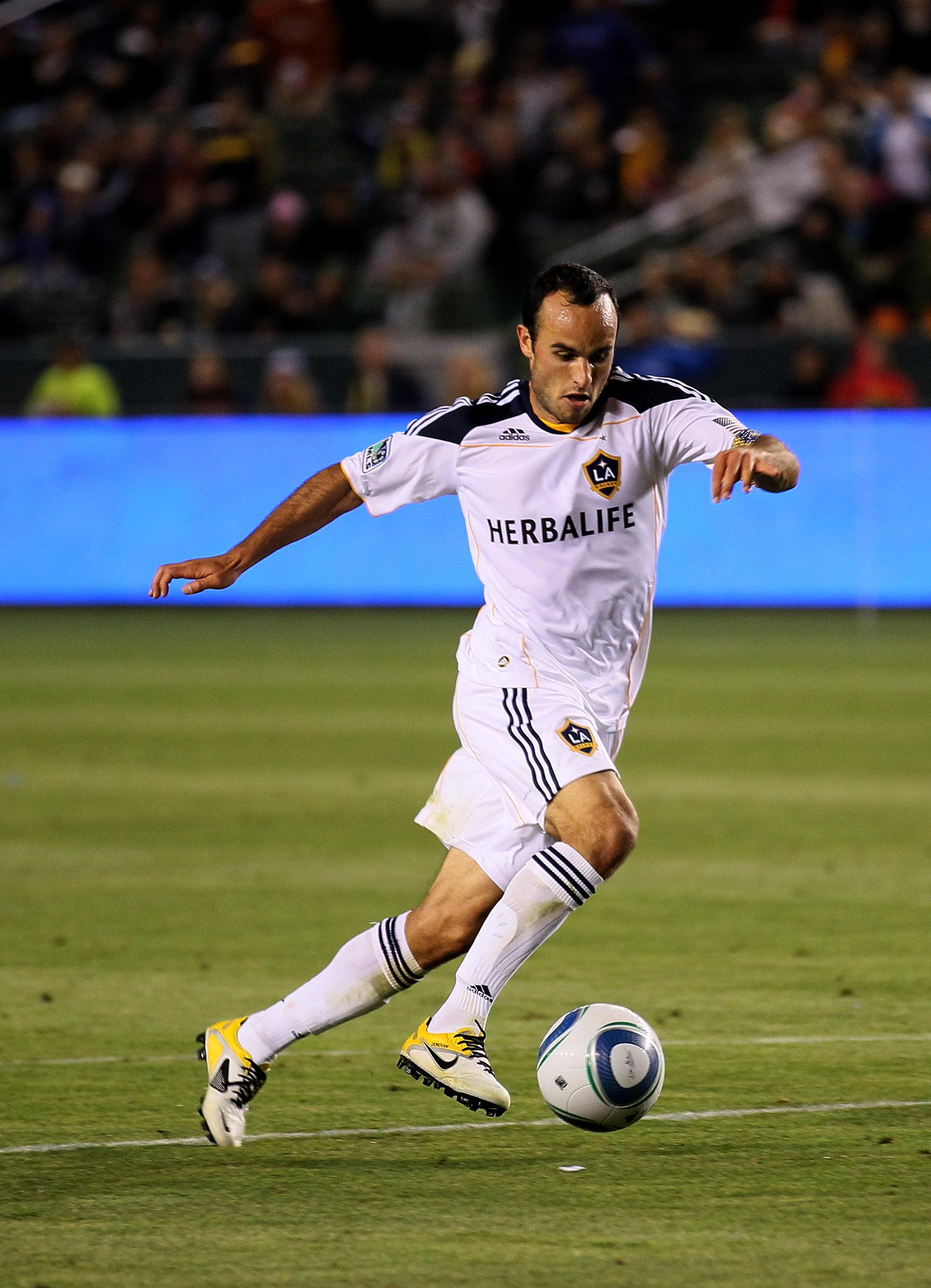 CARSON, CA - MAY 14:  Landon Donovan #10 of the Los Angeles Galaxy attacks with the ball against Sporting Kansas City at The Home Depot Center on May 14, 2011 in Carson, California.  The Galaxy won 4-1.  (Photo by Stephen Dunn/Getty Images)