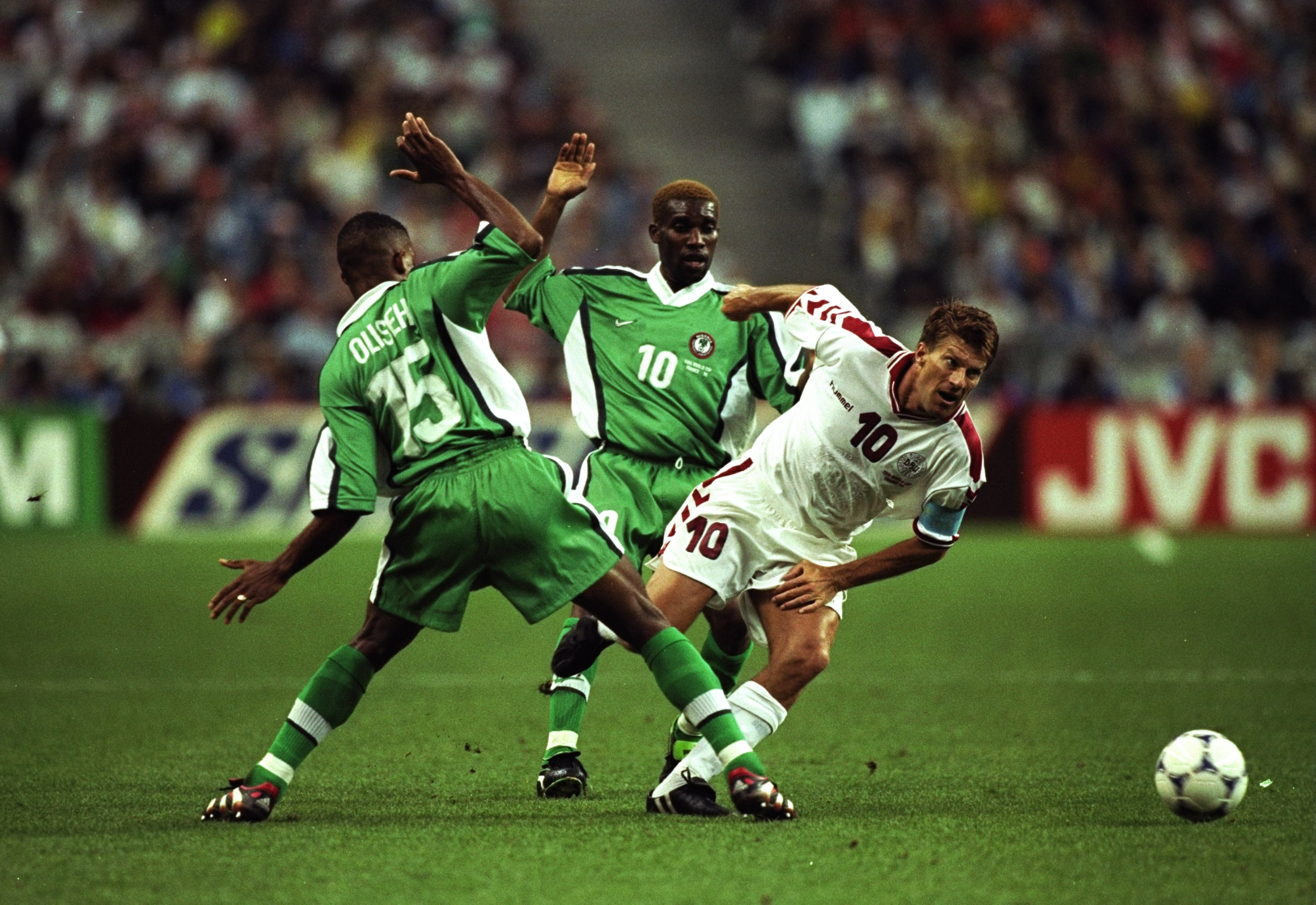 28 Jun 1998:  Denmark captain Michael Laudrup twists past Sunday Oliseh and Jay-Jay Okocha of Nigeria during the World Cup second round match at the Stade de France in St Denis, France. Denmark won 4-1. \ Mandatory Credit: Clive Brunskill /Allsport