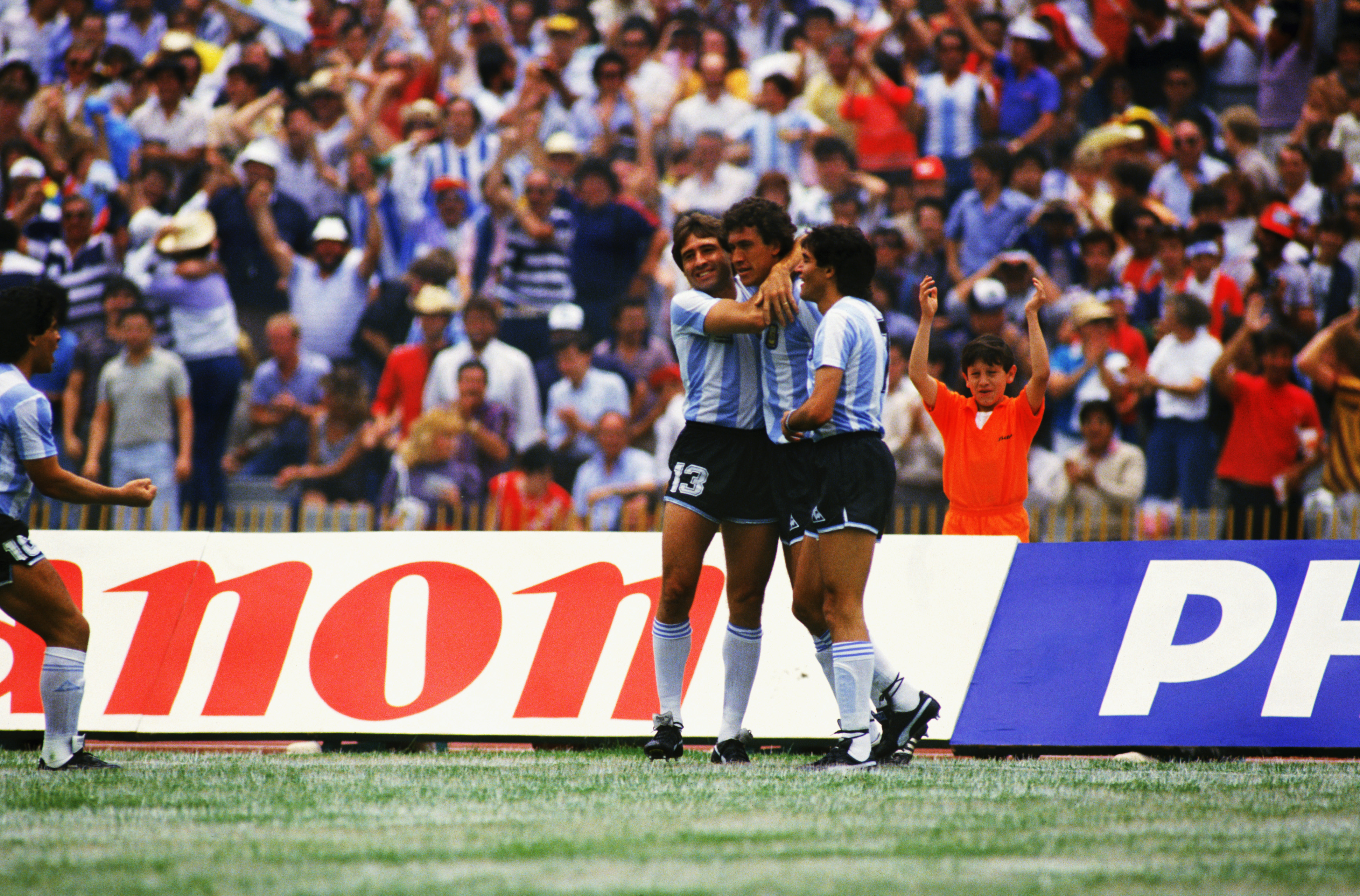 MEXICO CITY - JUNE 10:  Argentina players Oscar Garre (left) and Jose Burruchaga (right) congratulate goalscorer Jorge Valdano (centre) after he scored the opening goal of the match during the FIFA World Cup Finals 1986 Group A match between Argentina and