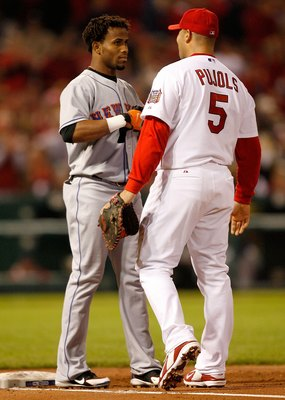 ST LOUIS - OCTOBER 15:  Albert Pujols #5 of the St. Louis Cardinals talks with Jose Reyes #7 of the New York Mets during game four of the NLCS at Busch Stadium on October 15, 2006 in St. Louis, Missouri.  (Photo by Dilip Vishwanat/Getty Images)