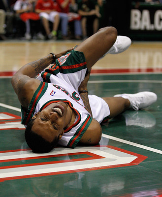 MILWAUKEE - APRIL 30: Brandon Jennings #3 of the Milwaukee Bucks grabs his leg after hitting the floor hard against the Atlanta Hawks in Game Six of the Eastern Conference Quarterfinals during the 2010 NBA Playoffs at the Bradley Center on April 30, 2010
