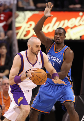 PHOENIX, AZ - MARCH 30:  Marcin Gortat #4 of the Phoenix Suns handles the ball during the NBA game against the Oklahoma City Thunder at US Airways Center on March 30, 2011 in Phoenix, Arizona.  The Thunder defeated the Suns 116-98. NOTE TO USER: User expr