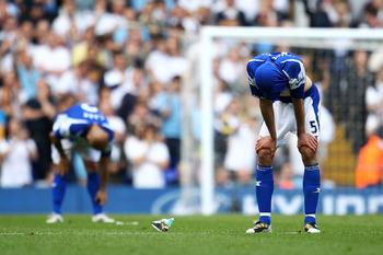 LONDON, ENGLAND - MAY 22:  Roger Johnson (R) of Birmingham City bows his head after Birmingham were relegated during the Barclays Premier League match between Tottenham Hotspur and Birmingham City at White Hart Lane on May 22, 2011 in London, England.  (P