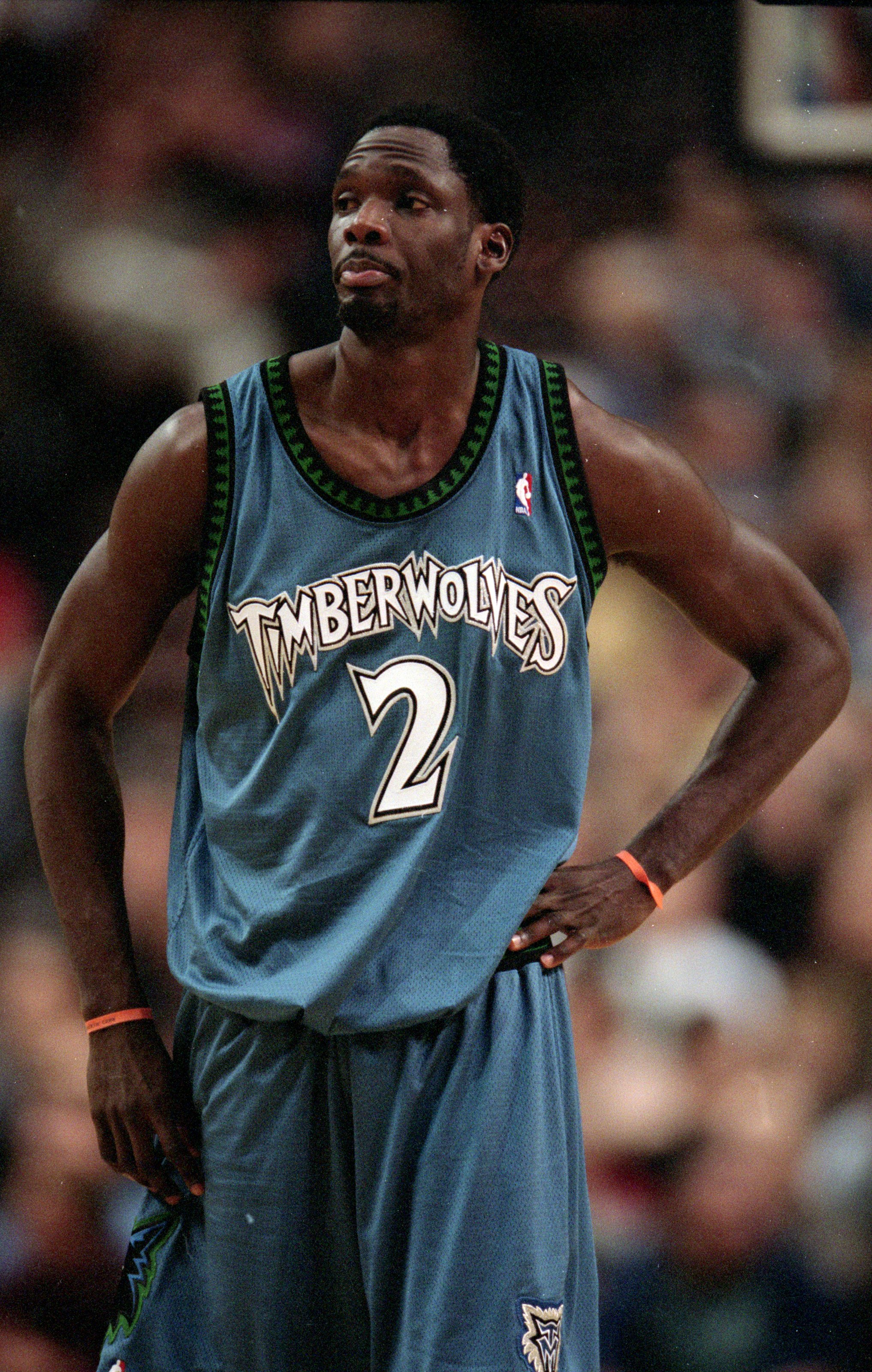 9 Dec 1999: Malik Sealy #2 of the Minnesota Timberwolves walks on the court during a game against the Portland TrailBlazers at the Rose Garden in Portland, Oregon. The Blazers defeated the Timberwolves 90-86.