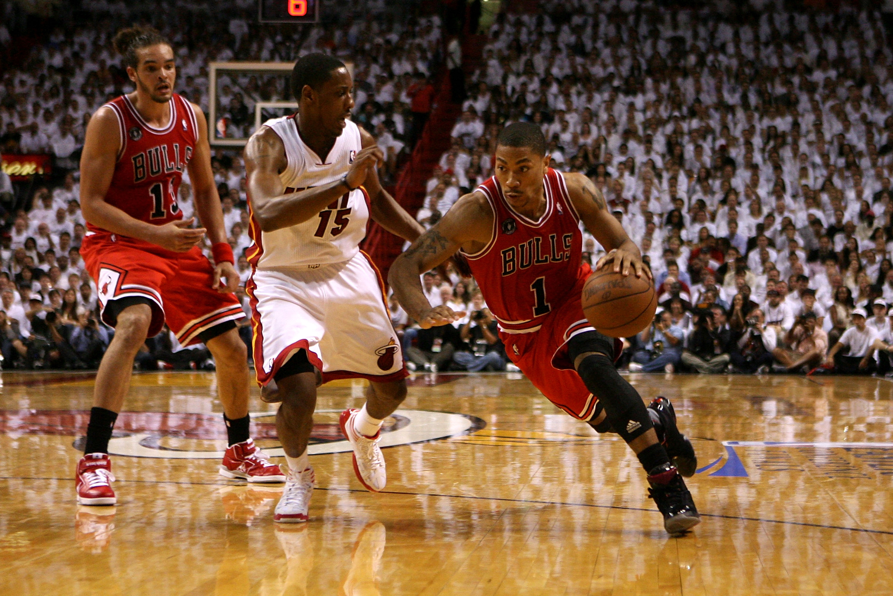 MIAMI, FL - MAY 22:  Derrick Rose #1 of the Chicago Bulls drives against Mario Chalmers #15 of the Miami Heat in Game Three of the Eastern Conference Finals during the 2011 NBA Playoffs on May 22, 2011 at American Airlines Arena in Miami, Florida.  NOTE T