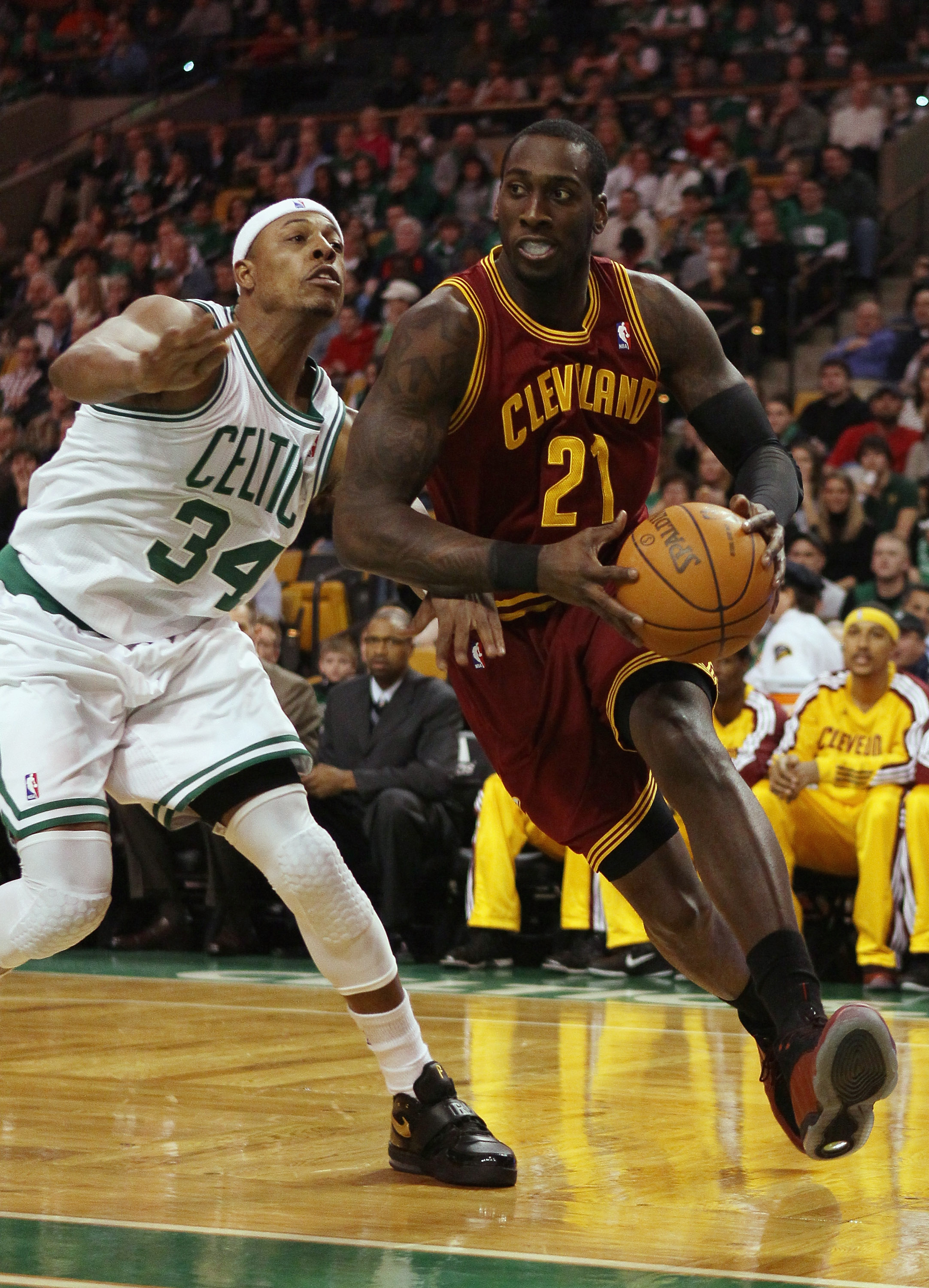 BOSTON, MA - JANUARY 25:  J.J. Hickson #21 of the of the Cleveland Cavaliers heads for the net as Paul Pierce #34 of the Boston Celtics defends on January 25, 2011 at the TD Garden in Boston, Massachusetts.   NOTE TO USER: User expressly acknowledges and