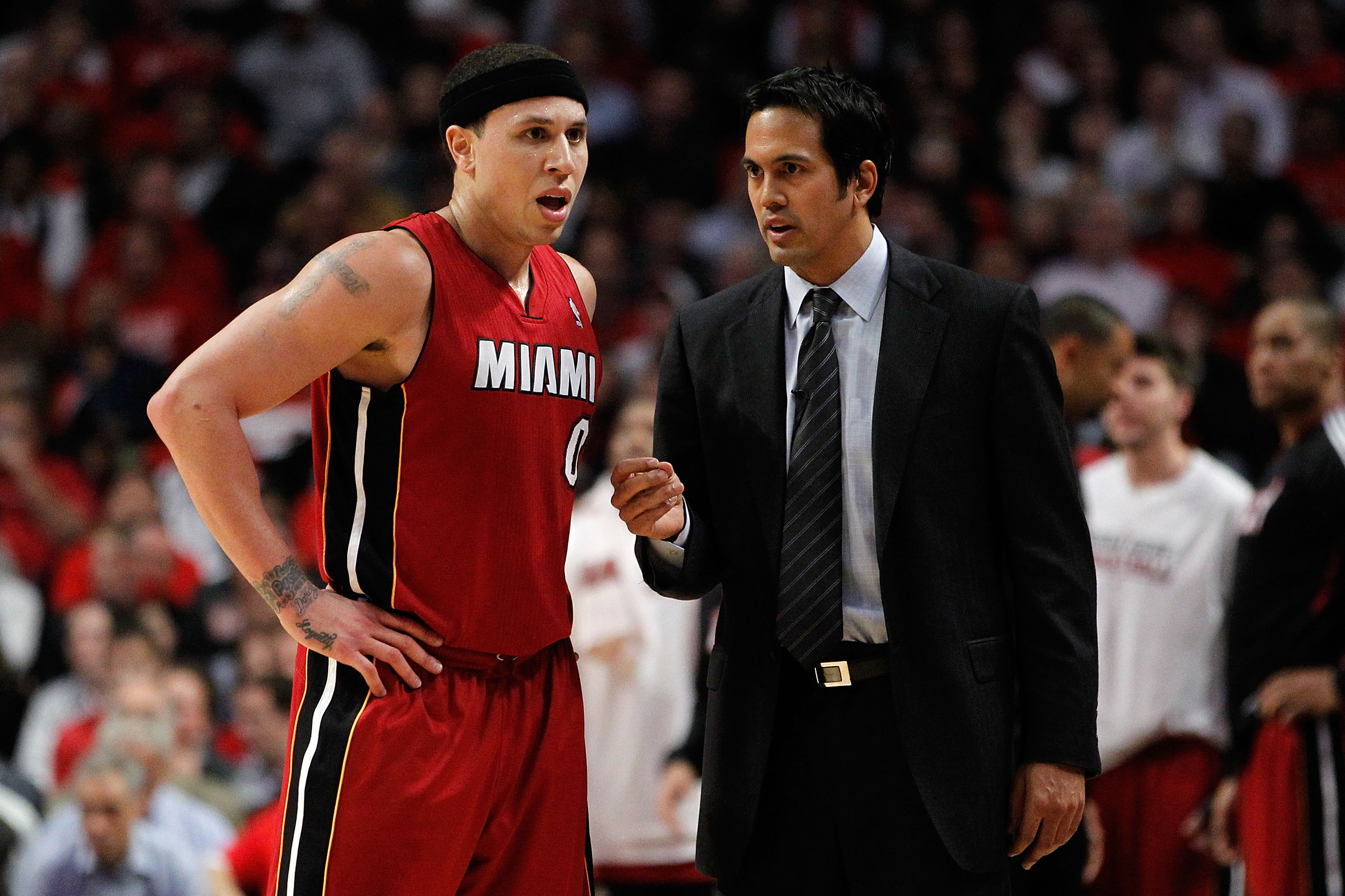 CHICAGO, IL - MAY 18:  (L-R) Mike Bibby #0 and head coach Erik Spoelstra of the Miami Heat against the Chicago Bulls in Game Two of the Eastern Conference Finals during the 2011 NBA Playoffs on May 18, 2011 at the United Center in Chicago, Illinois. NOTE