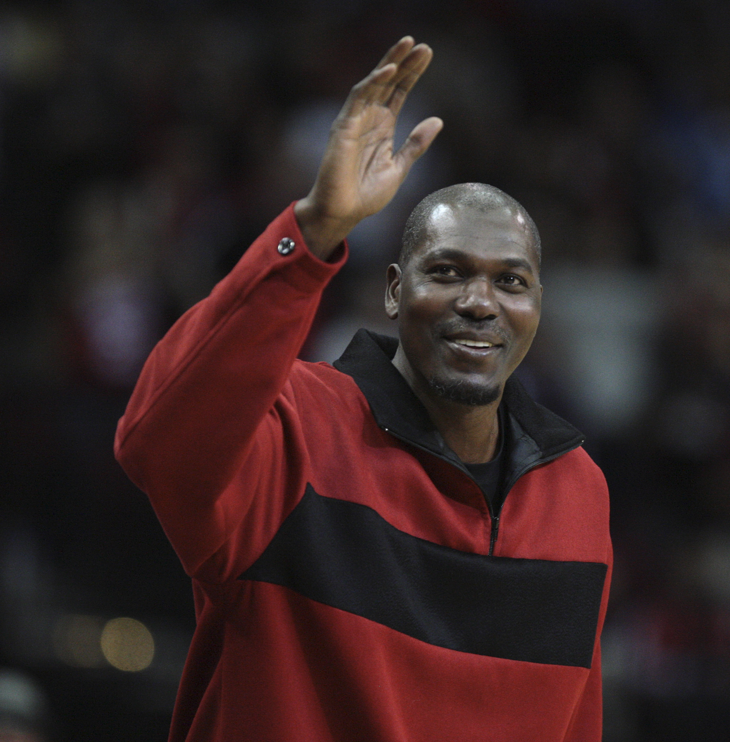HOUSTON - DECEMBER 29:  Former Houston Rockets Hakeem Olajuwon waves to the crowd as he is introduced to the crowd at Toyota Center on December 29, 2010 in Houston, Texas.  NOTE TO USER: User expressly acknowledges and agrees that, by downloading and or u