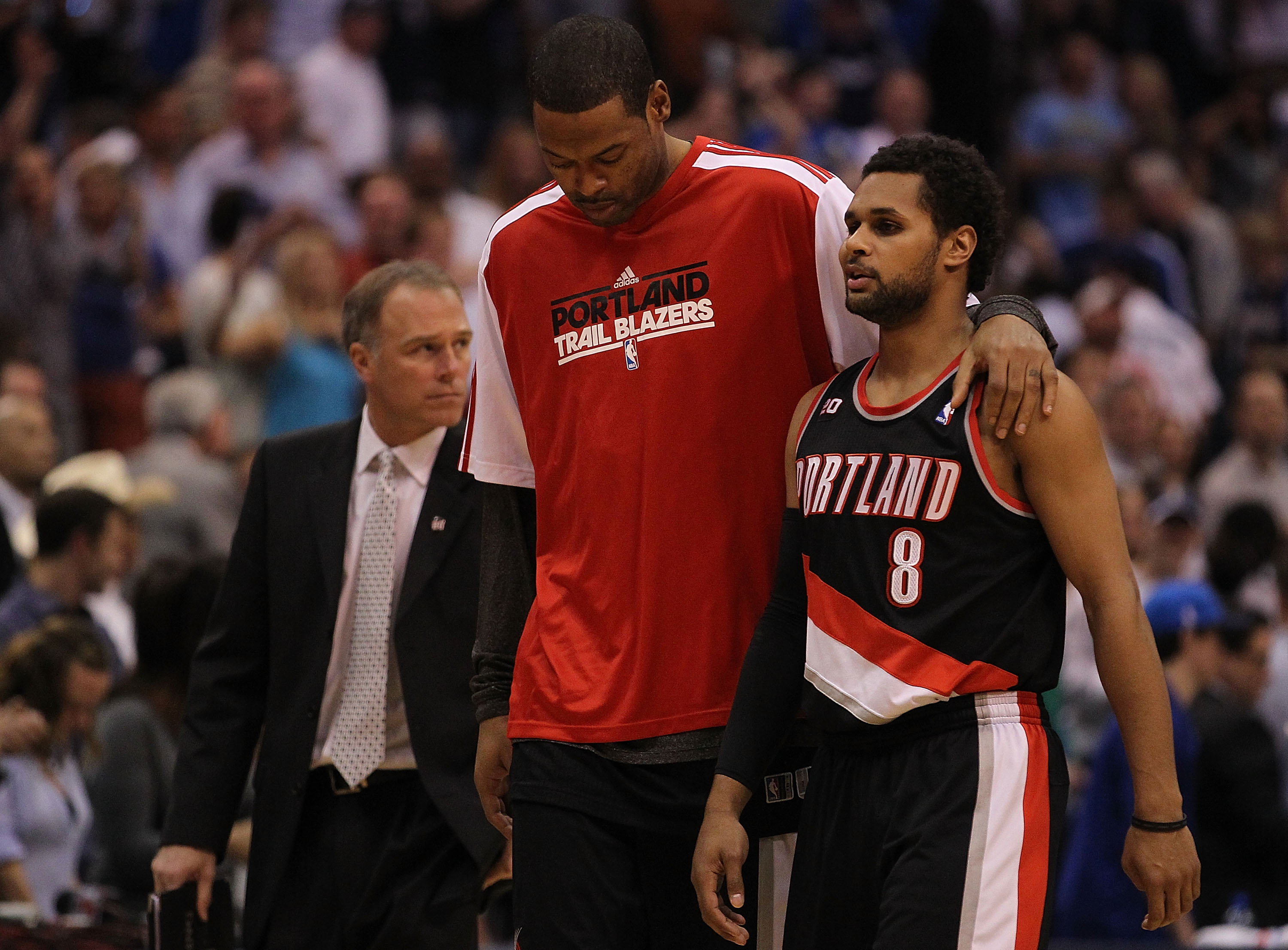 DALLAS, TX - APRIL 25:  (L-R) Marcus Camby #23 and Patrick Mills #8 of the Portland Trail Blazers walk off the court after a loss against the Dallas Mavericks in Game Five of the Western Conference Quarterfinals during the 2011 NBA Playoffs on April 25, 2