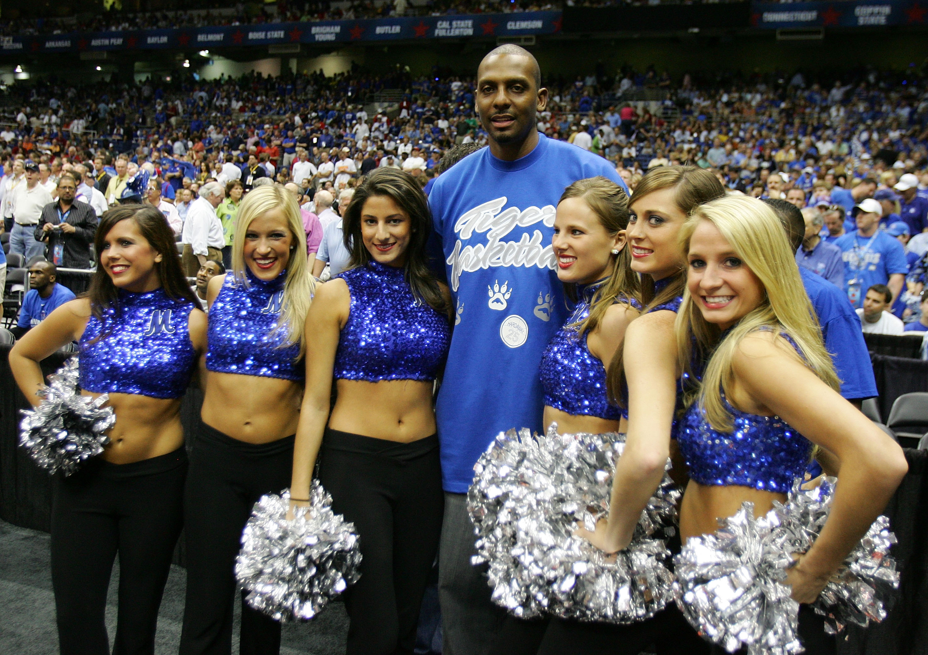 SAN ANTONIO - APRIL 07:  Former Memphis Tigers player Anfernee ?Penny? Hardaway poses with the Tigers dance team prior to the start of the 2008 NCAA Men's National Championship game against the Kansas Jayhawks at the Alamodome on April 7, 2008 in San Anto