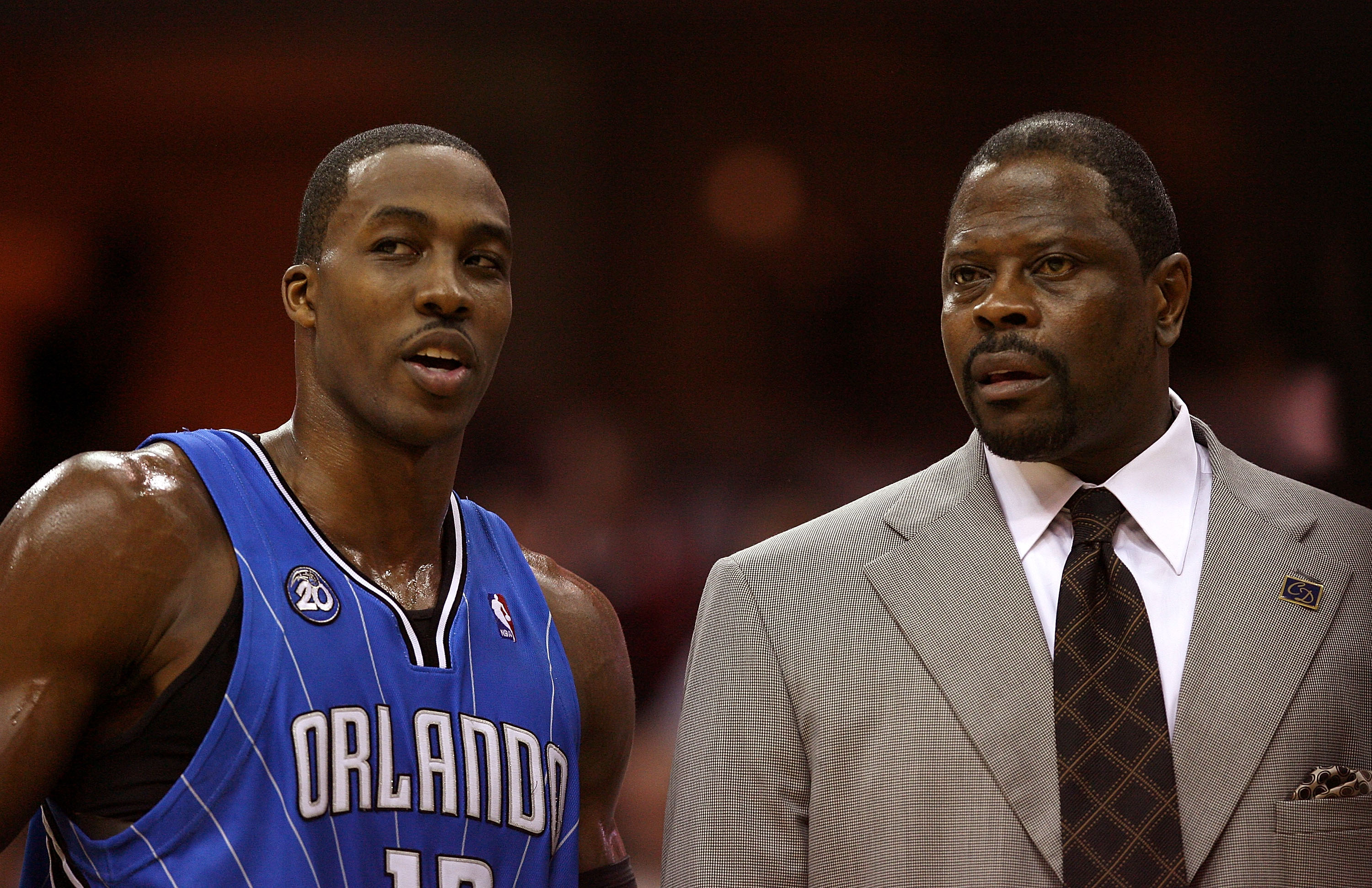 CLEVELAND - MAY 28: Dwight Howard #12 and assistant coach Patrick Ewing of the Orlando Magic talk on the sideline against the Cleveland Cavaliers in Game Five of the Eastern Conference Finals during the 2009 Playoffs at Quicken Loans Arena on May 28, 2009