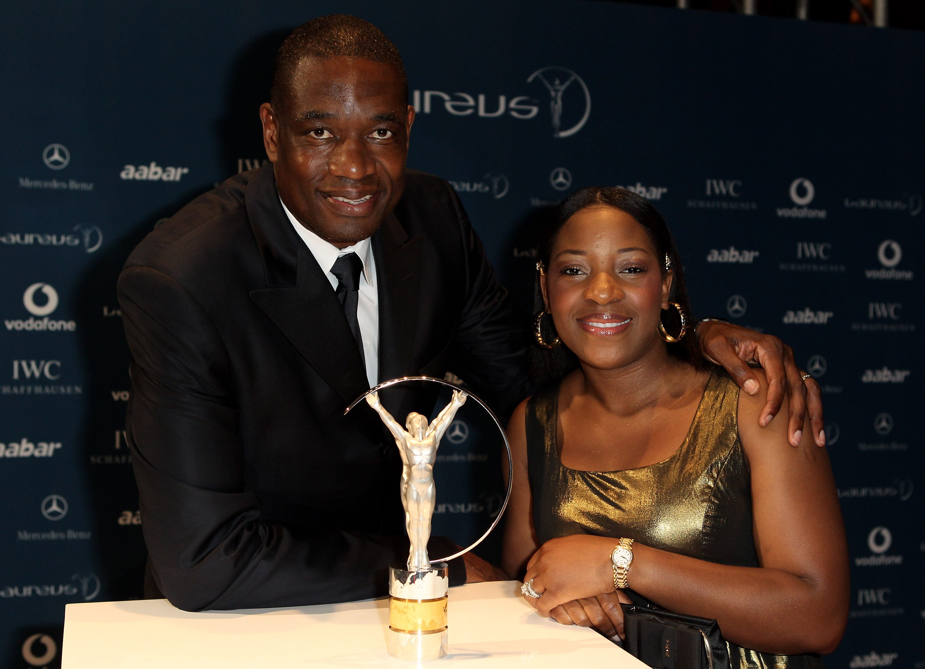 ABU DHABI, UNITED ARAB EMIRATES - MARCH 10:  US basketball legend Dikembe Mutombo and his wife Rose Mutumbo arrive at the Laureus World Sports Awards 2010 at Emirates Palace Hotel on March 10, 2010 in Abu Dhabi, United Arab Emirates.  (Photo by Ian Walton