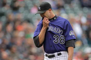 DENVER, CO - MAY 01:  Starting pitcher Ubaldo Jimenez #38 of the Colorado Rockies heads for the dugout at the end of the fourth inning agaisnt the Pittsburgh Pirates at Coors Field on May 1, 2011 in Denver, Colorado. Jimenez collected the loss as the Pira