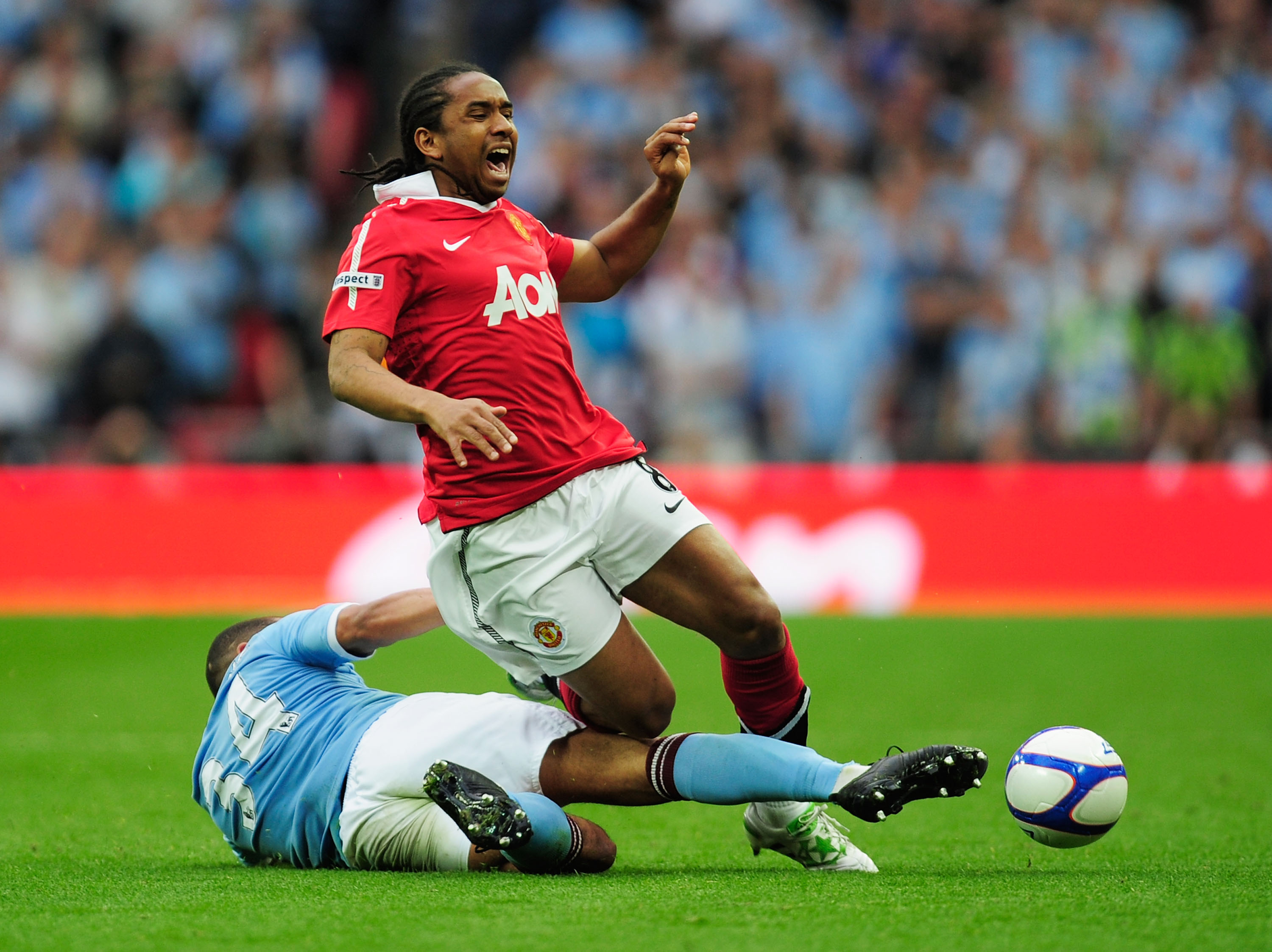 LONDON, ENGLAND - APRIL 16:  Nigel de Jong of Manchester City tackles Anderson of Manchester United during the FA Cup sponsored by E.ON semi final match between Manchester City and Manchester United at Wembley Stadium on April 16, 2011 in London, England.
