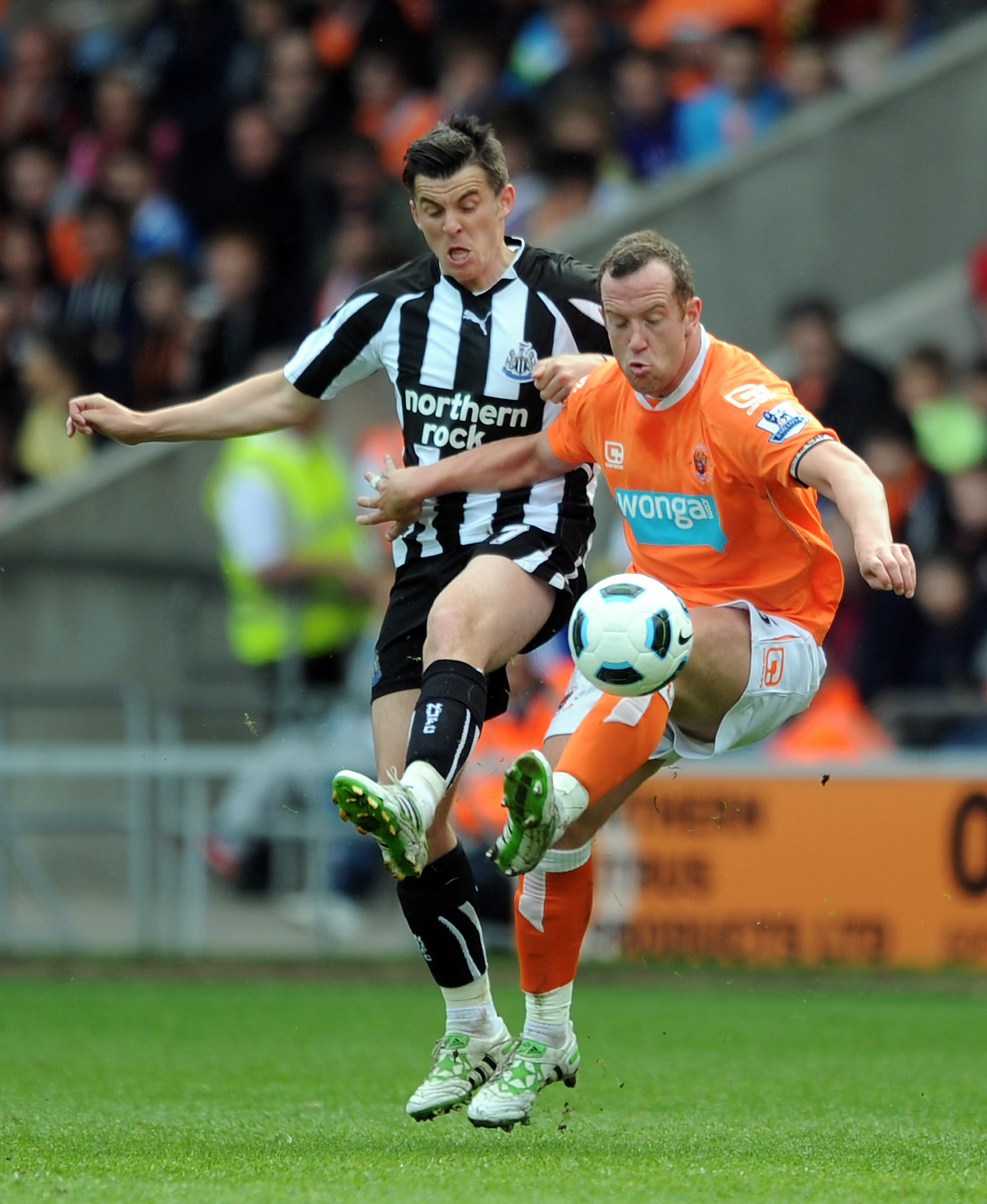 BLACKPOOL, ENGLAND - APRIL 23: Charlie Adam of Blackpool competes with Joey Barton of Newcastle United during the Barclays Premier League match between Blackpool and Newcastle United at Bloomfield Road on April 23, 2011 in Blackpool, England.  (Photo by C