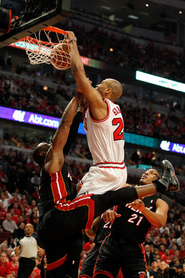 CHICAGO, IL - MAY 15:  Taj Gibson #22 of the Chicago Bulls dunks against Dwyane Wade #3 of the Miami Heat in Game One of the Eastern Conference Finals during the 2011 NBA Playoffs on May 15, 2011 at the United Center in Chicago, Illinois. The Bulls won 10