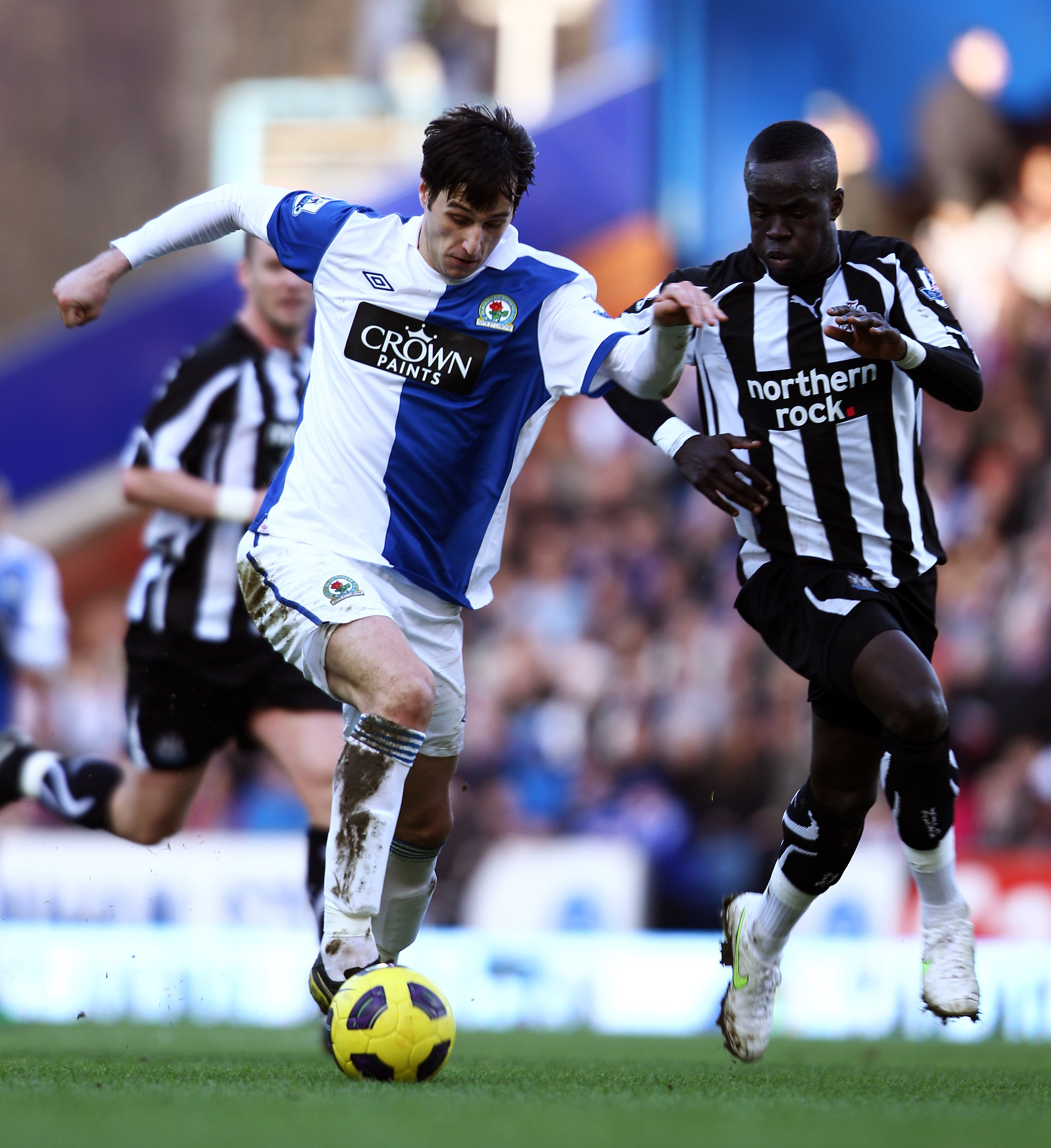BLACKBURN, ENGLAND - FEBRUARY 12:  Nikola Kalinic of Blackburn and Cheik Tiote of Newcastle chase the ball during the Barclays Premier League match between Blackburn Rovers and Newcastle United at Ewood Park on February 12, 2011 in Blackburn, England.  (P