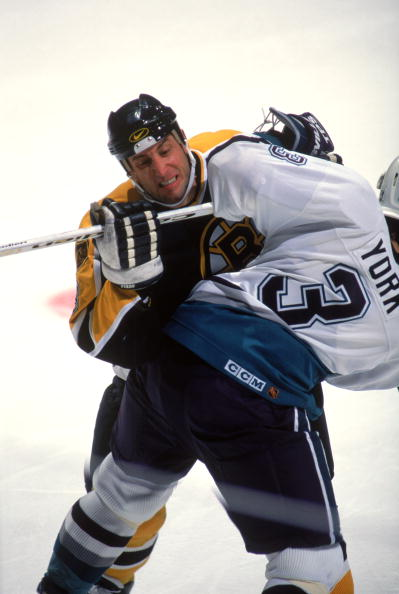 21 Feb 1996:  Right-winger Cam Neely of the Boston Bruins and a Anaheim Mighty Ducks player get tangled during a game at Arowhead Pond in Anaheim, California.  The Mighty Ducks won the game, 4-3. Mandatory Credit: Glenn Cratty  /Allsport