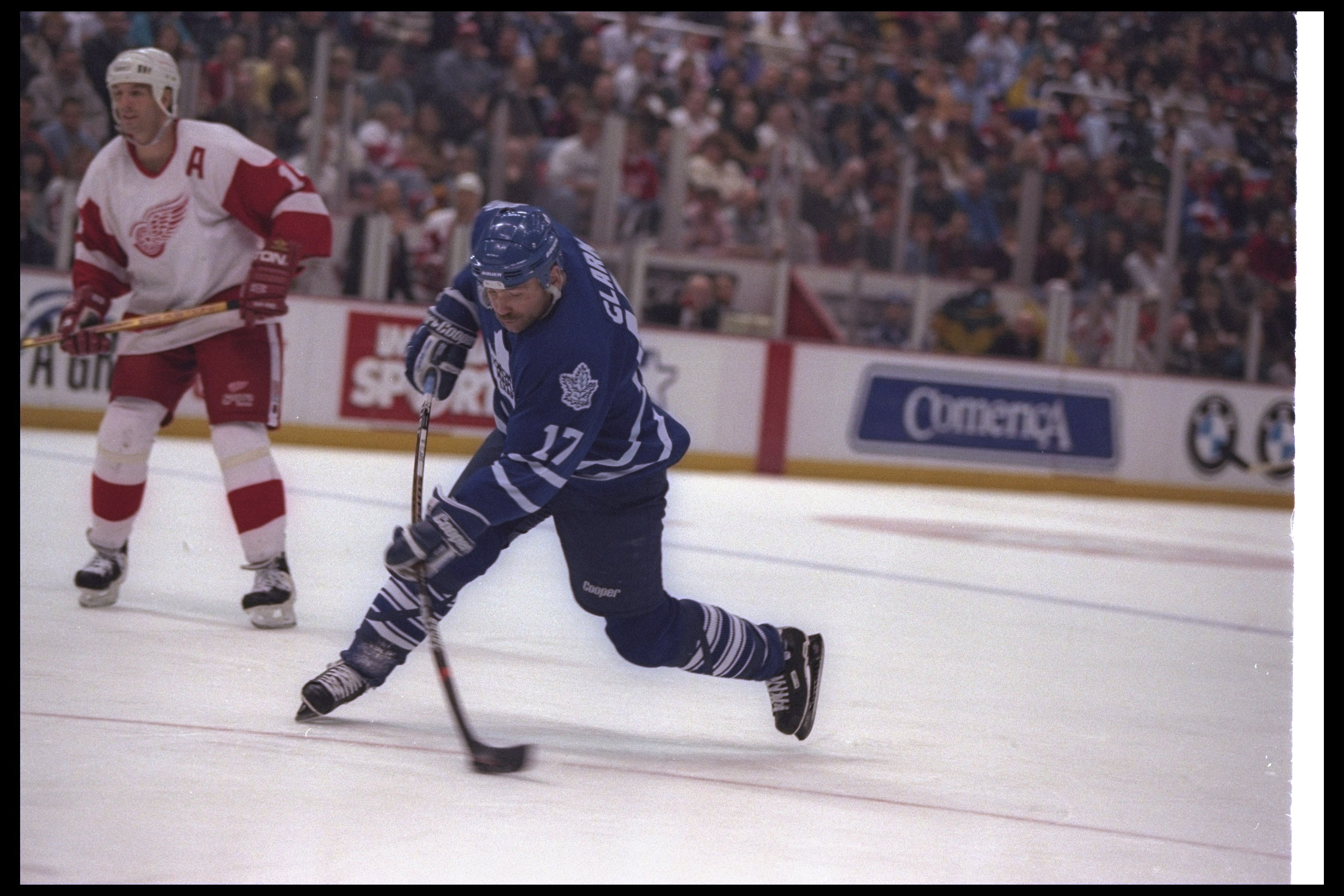 27 Nov 1996:  Leftwinger Wendel Clark of the Toronto Maple Leafs moves the puck as Detroit Red Wings player Brendan Shanahan looks on during a game at Joe Louis Arena in Detroit, Michigan.  The Red Wings won the game, 5-2. Mandatory Credit: Rick Stewart
