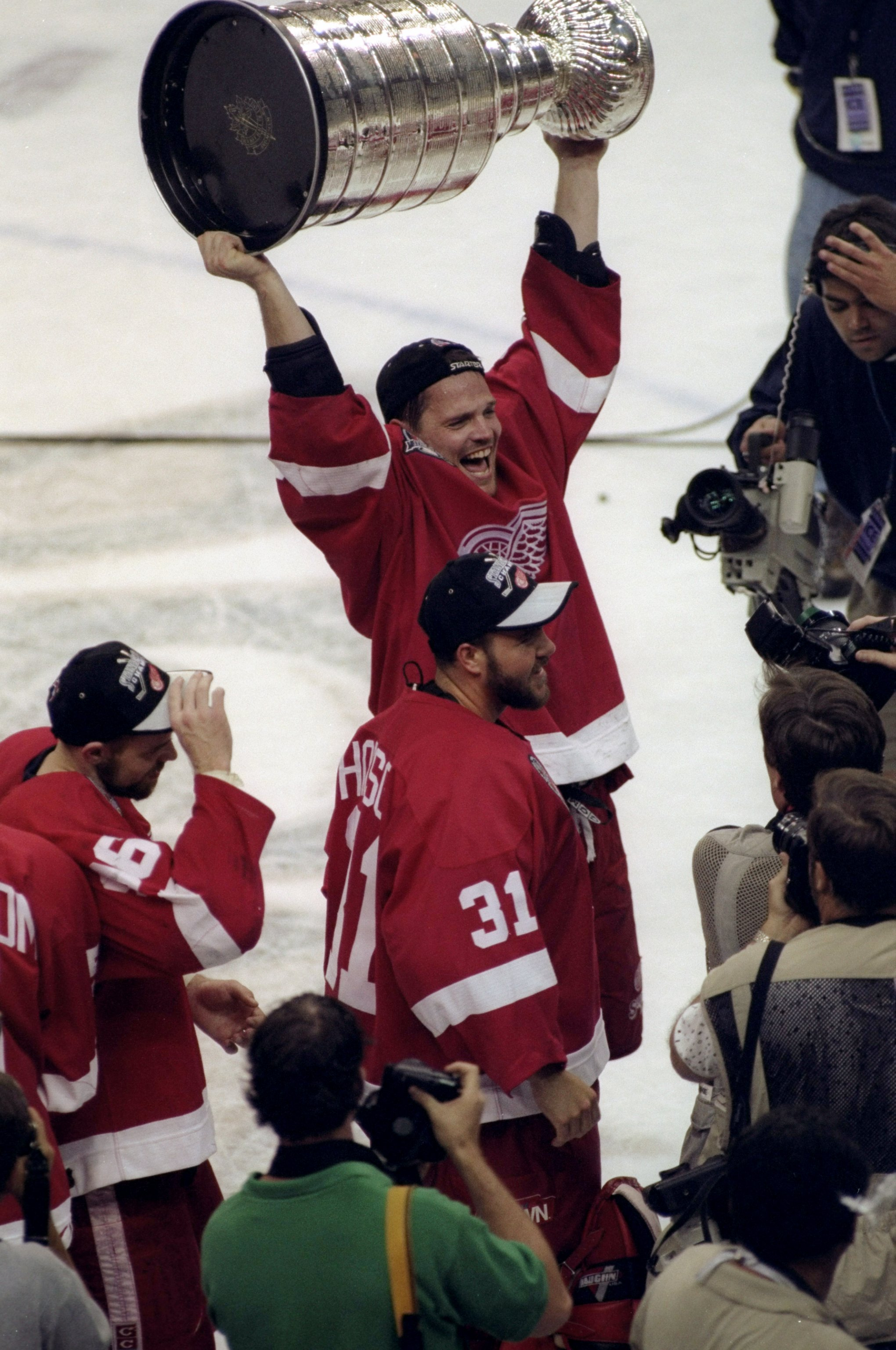 16 Jun 1998:  Joe Kocur #26 of the Detroit Red Wings holds up the Stanley Cup during the Stanley Cup Finals game against the Washington Capitals at the MCI Center in Washington, D. C.. The Red Wings defeated the Capitals 4-1. Mandatory Credit: Craig Melvi