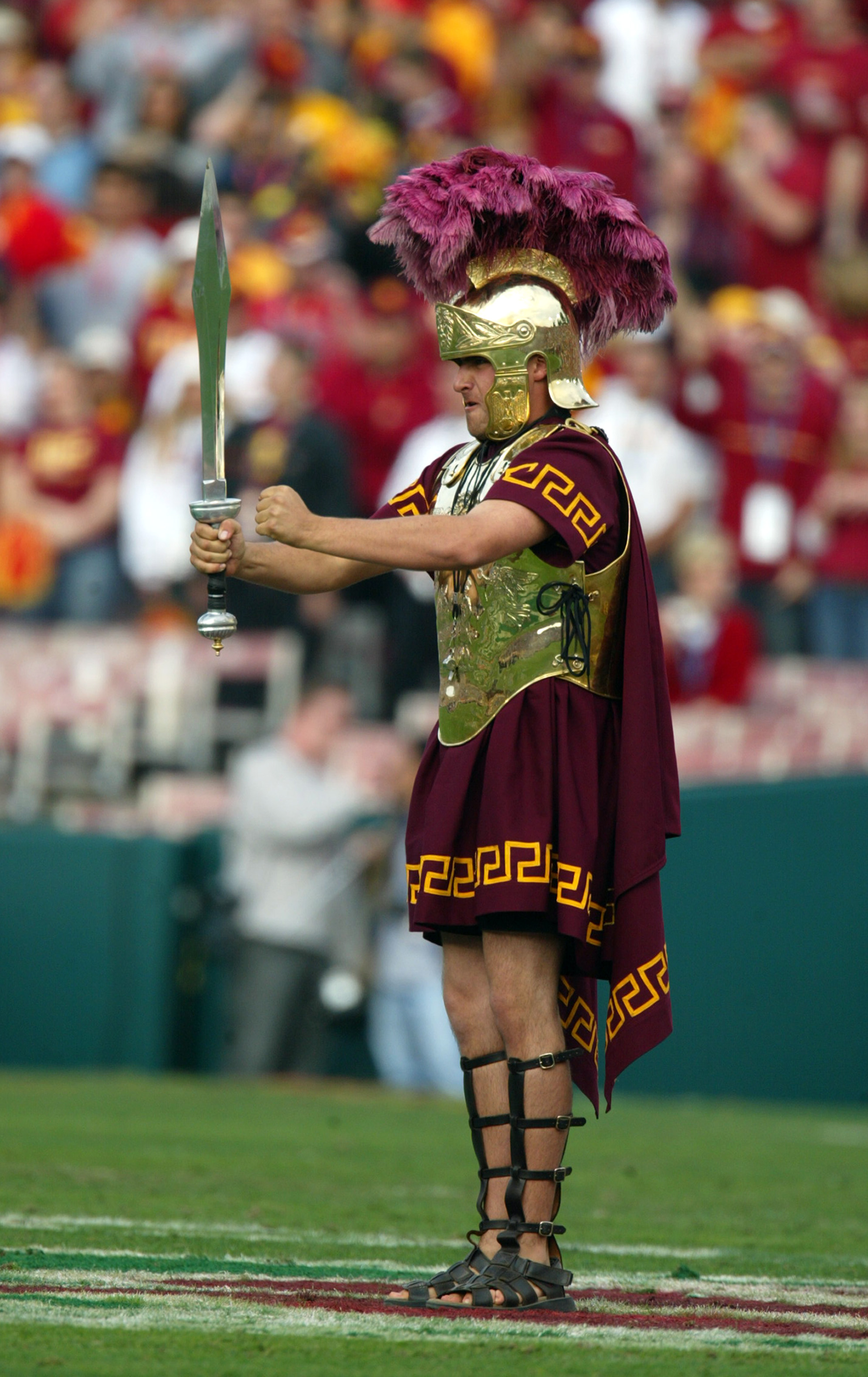 PASADENA, CA - JANUARY 1:  Tommy Trojan, mascot of the USC Trojans entertains the crowd during an intermission in the 2004 Rose Bowl game against the Michigan Wolverines on January 1, 2004 at the Rose Bowl in Pasadena, California.  USC defeated Michigan 2