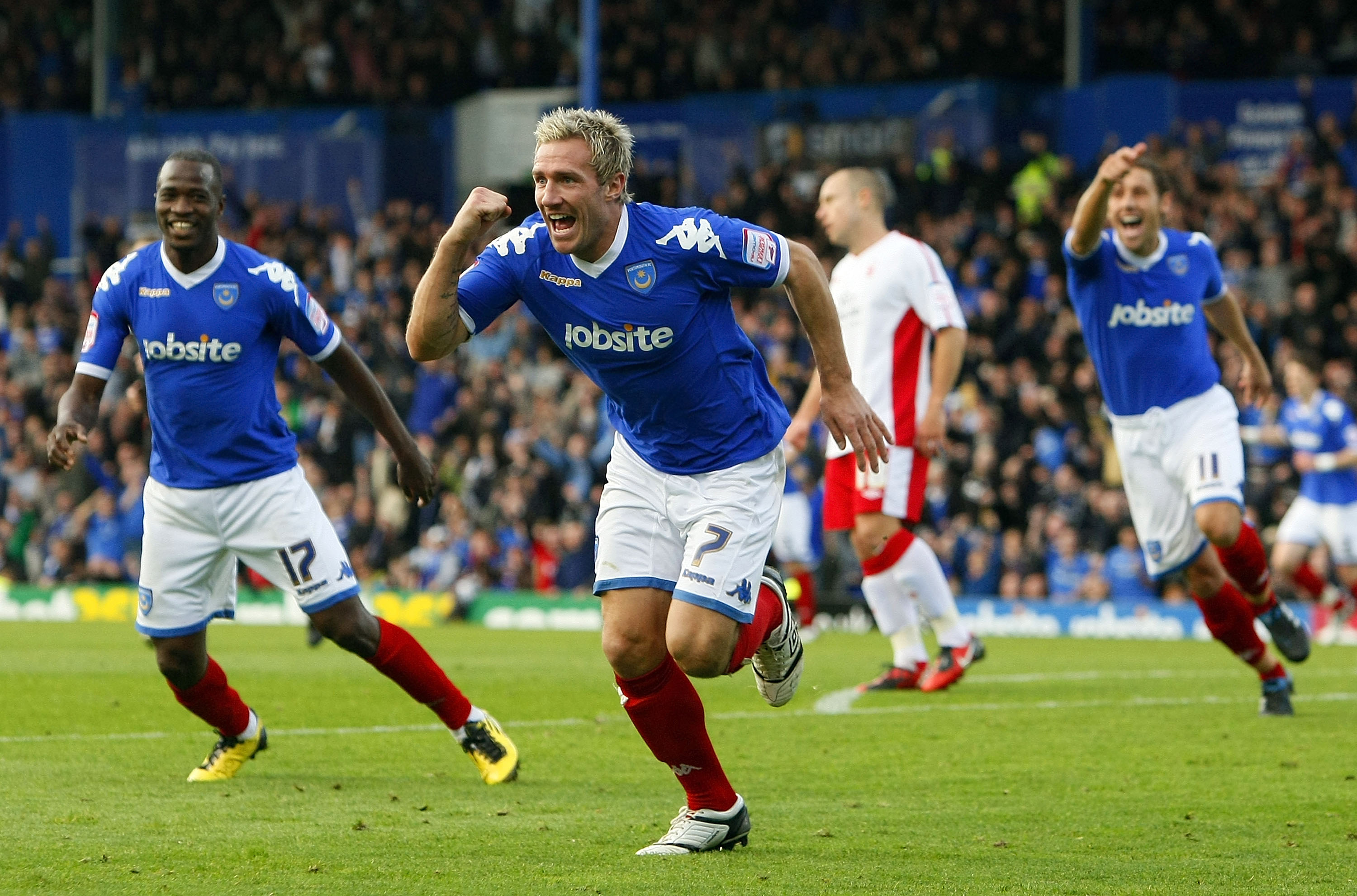 PORTSMOUTH, ENGLAND - OCTOBER 30: Liam Lawrence of Portsmouth celebrates his goal during the npower Championship match between Portsmouth and Nottingham Forest at Fratton Park on October 30, 2010 in Portsmouth, England. (Photo by Tom Dulat/Getty Images)