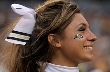 DENVER - AUGUST 31:  A University of Colorado Buffaloes cheerleader supports her team against the Colorado State University Rams at Invesco Field at Mile High on August 31, 2008 in Denver, Colorado. Colorado defeated Colorado State 38-17 to win the Centen