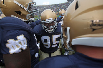 SOUTH BEND, IN - SEPTEMBER 11: Ian Williams #95 of the Notre Dame Fighting Irish fires up his defensive teammates during warm-ups before a game against the Michigan Wolverines at Notre Dame Stadium on September 11, 2010 in South Bend, Indiana. Michigan de