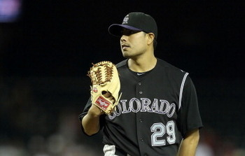 PHOENIX, AZ - MAY 03:  Starting pitcher Jorge De La Rosa #29 of the Colorado Rockies pitches against the Arizona Diamondbacks during the Major League Baseball game at Chase Field on May 3, 2011 in Phoenix, Arizona.  The Diamondbacks defeated the Rockies 4