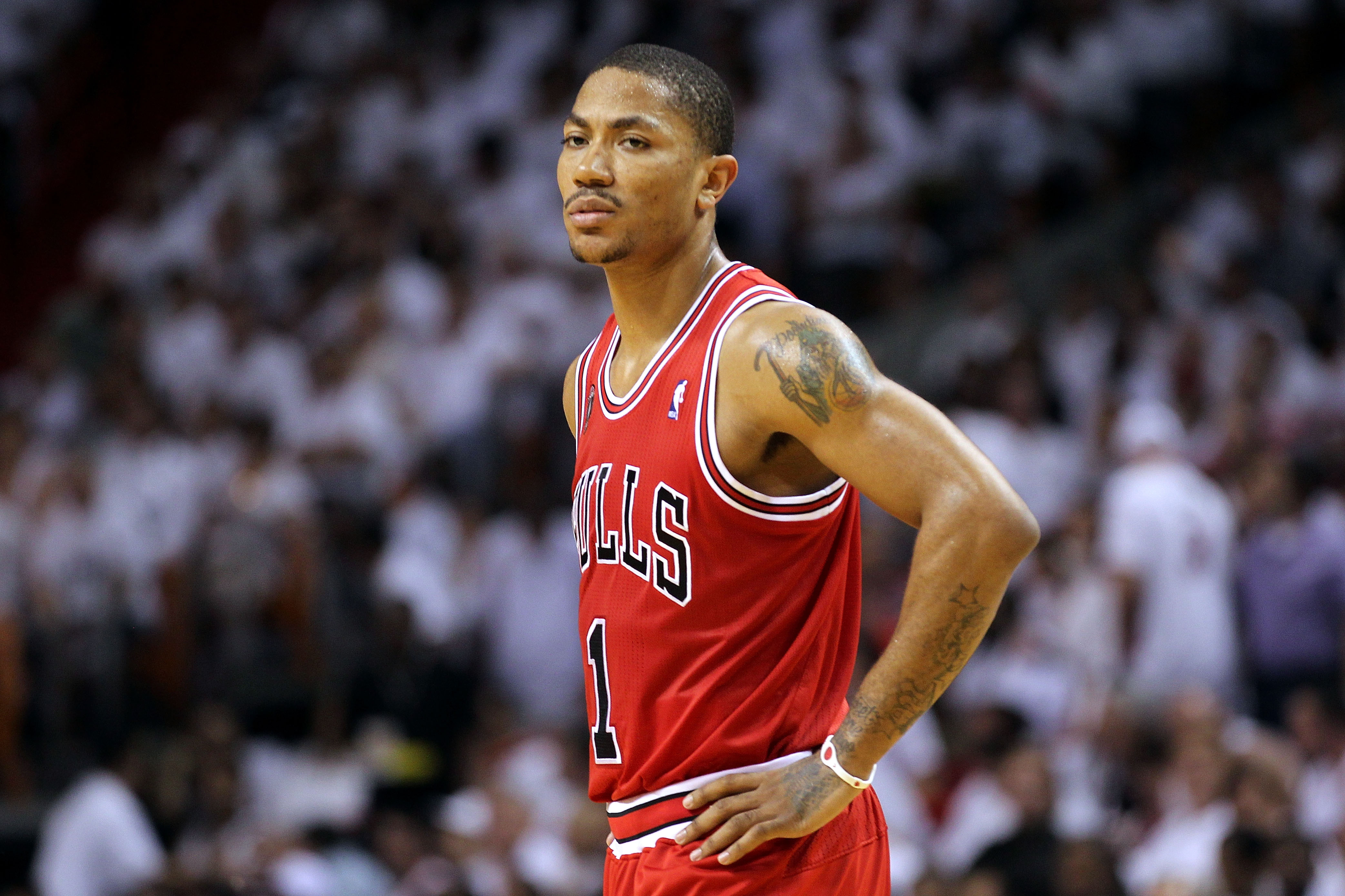 MIAMI, FL - MAY 24:  Derrick Rose #1 of the Chicago Bulls looks on against the Miami Heat in Game Four of the Eastern Conference Finals during the 2011 NBA Playoffs on May 24, 2011 at American Airlines Arena in Miami, Florida. NOTE TO USER: User expressly