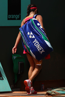 PARIS, FRANCE - MAY 24:  A dejected Ana Ivanovic of Serbia walks off court following her defeat during the women's singles round one match between Johanna Larsson of Sweden and Ana Ivanovic of Serbia on day three of the French Open at Roland Garros on May