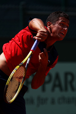 PARIS, FRANCE - MAY 24:  Nicolas Almagro of Spain serves during the men's singles round one match between Nicolas Almagro of Spain and Lukasz Kubot of Poland on day three of the French Open at Roland Garros on May 24, 2011 in Paris, France.  (Photo by Ale