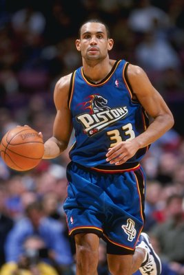 24 Mar 1999: Grant Hill #33 of the Detroit Pistons dribbles the ball during a game against the New Jersey Nets at the Continental Airlines Arena in East Rutherford, New Jersey. The Piston defeated the Nets 84-71.