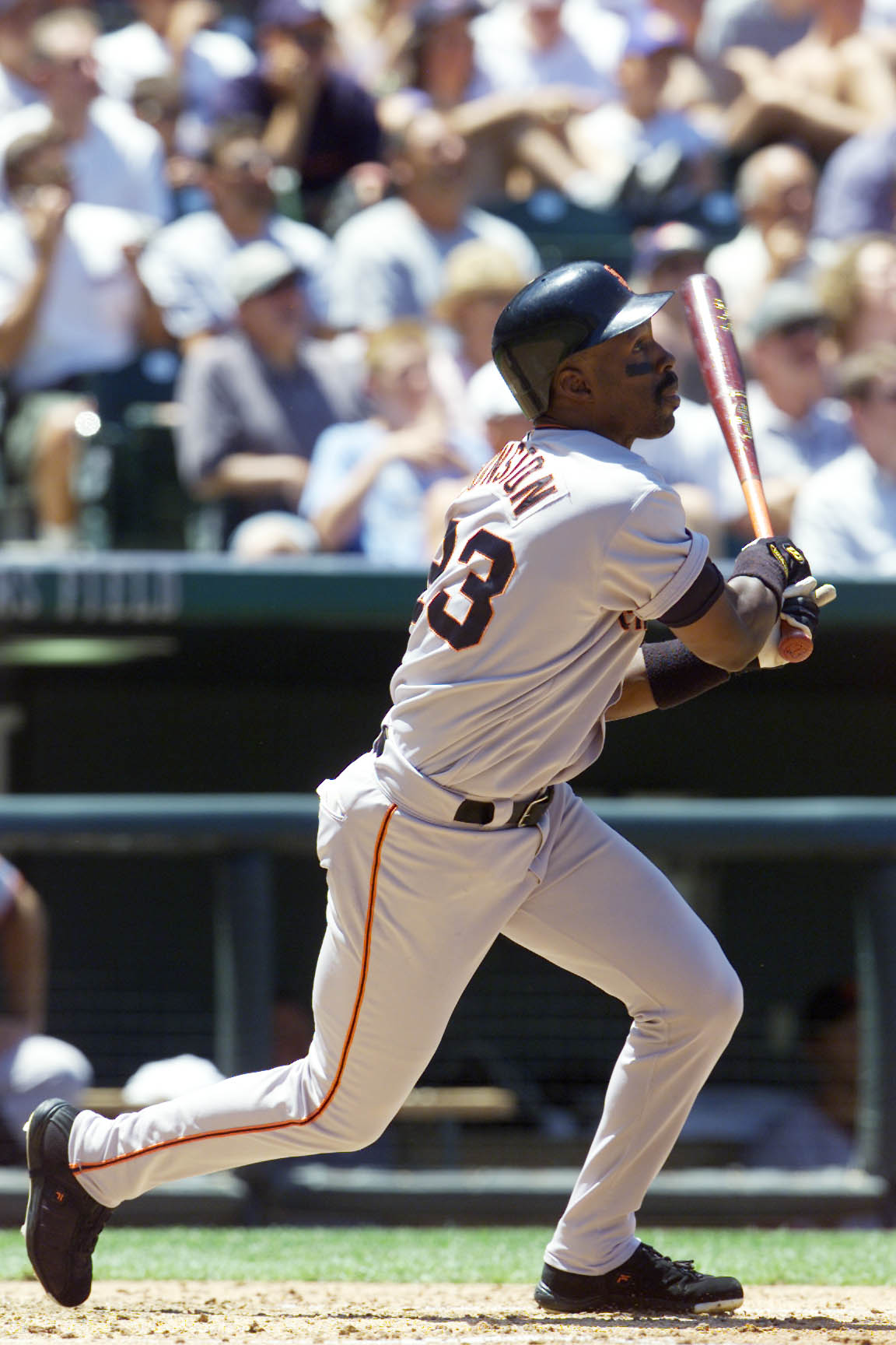 25 Jul 2001: Shawon Dunston hits against the Colorado Rockies at Coors Field in Denver, Colorado. DIGITAL IMAGE. Mandatory Credit: Brian Bahr/Allsport