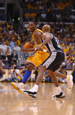 LOS ANGELES - MAY 5:  Guard Kobe Bryant #8 of the Los Angeles Lakers drives past guard Bruce Bowen #12 of the San Antonio Spurs during game one of the Western Conference Semifinals during the 2002 NBA Playoffs at Staples Center in Los Angeles, California