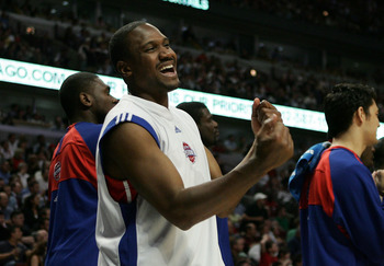 CHICAGO - MAY 10:  Lindsey Hunter #10 of the Detroit Pistons celebrates late in the game on the bench against the Chicago Bulls in Game Three of the Eastern Conference Semifinals during the 2007 NBA Playoffs at the United Center Center on May 10, 2007 in