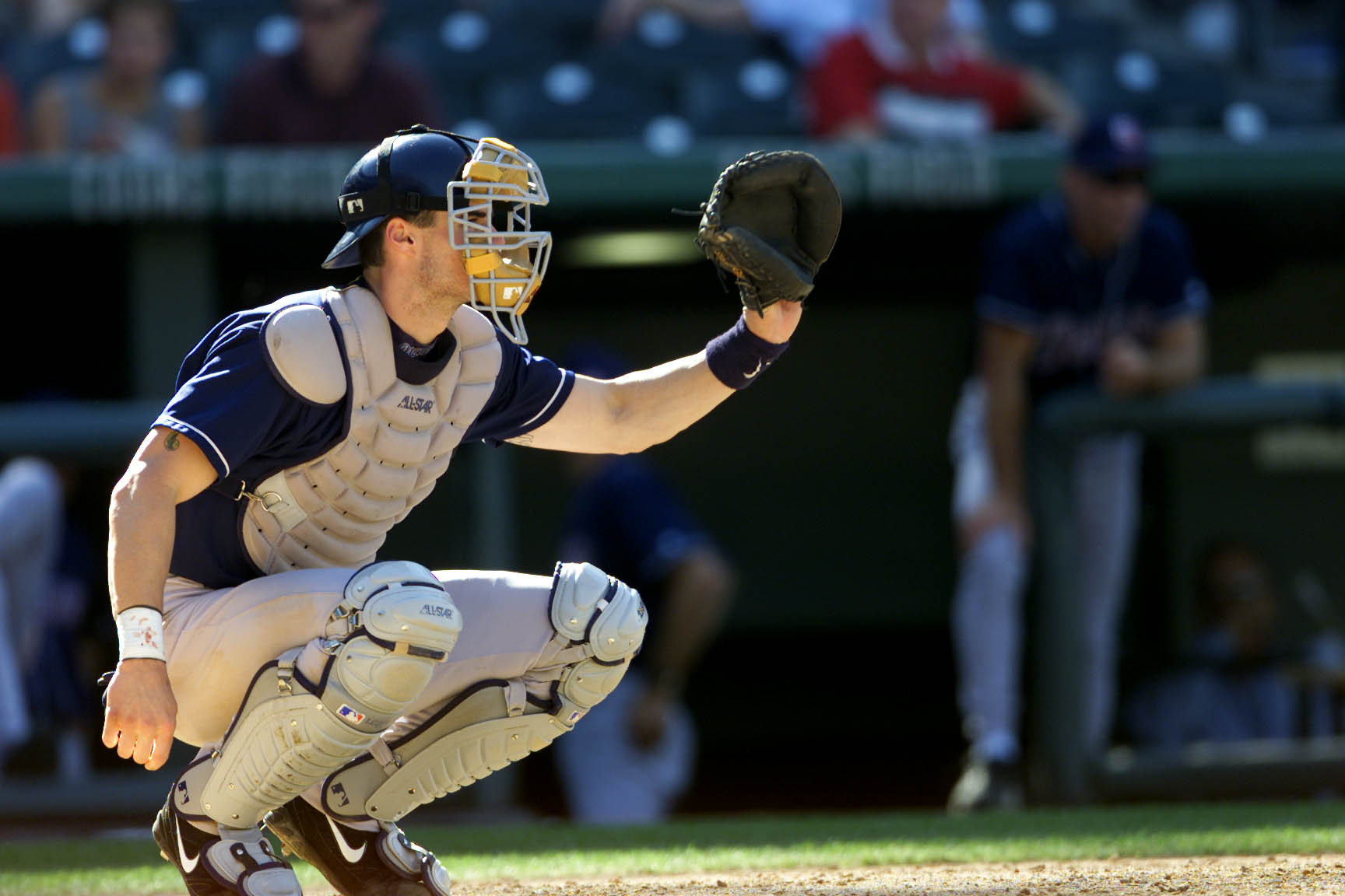 27 Sep 2001: Catcher Ben Davis of the San Diego padres aims for a save against the Colorado Rockies during the game at Coors Field in Denver, Colorado. The Rockies won 13-9 . DIGITAL IMAGE. Mandatory Credit: Brian Bahr/Allsport